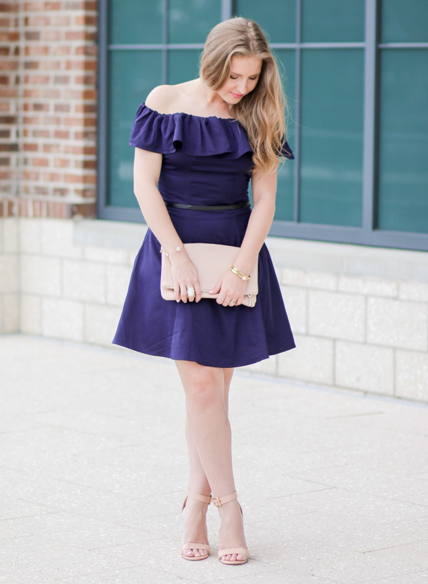 I'm loving this navy-off-the-shoulder dress styled by Ashley Brooke Nicholas! The navy looks amazing combined with the rose quartz fold-over clutch from Express and the chunky ankle-strap nude heels!