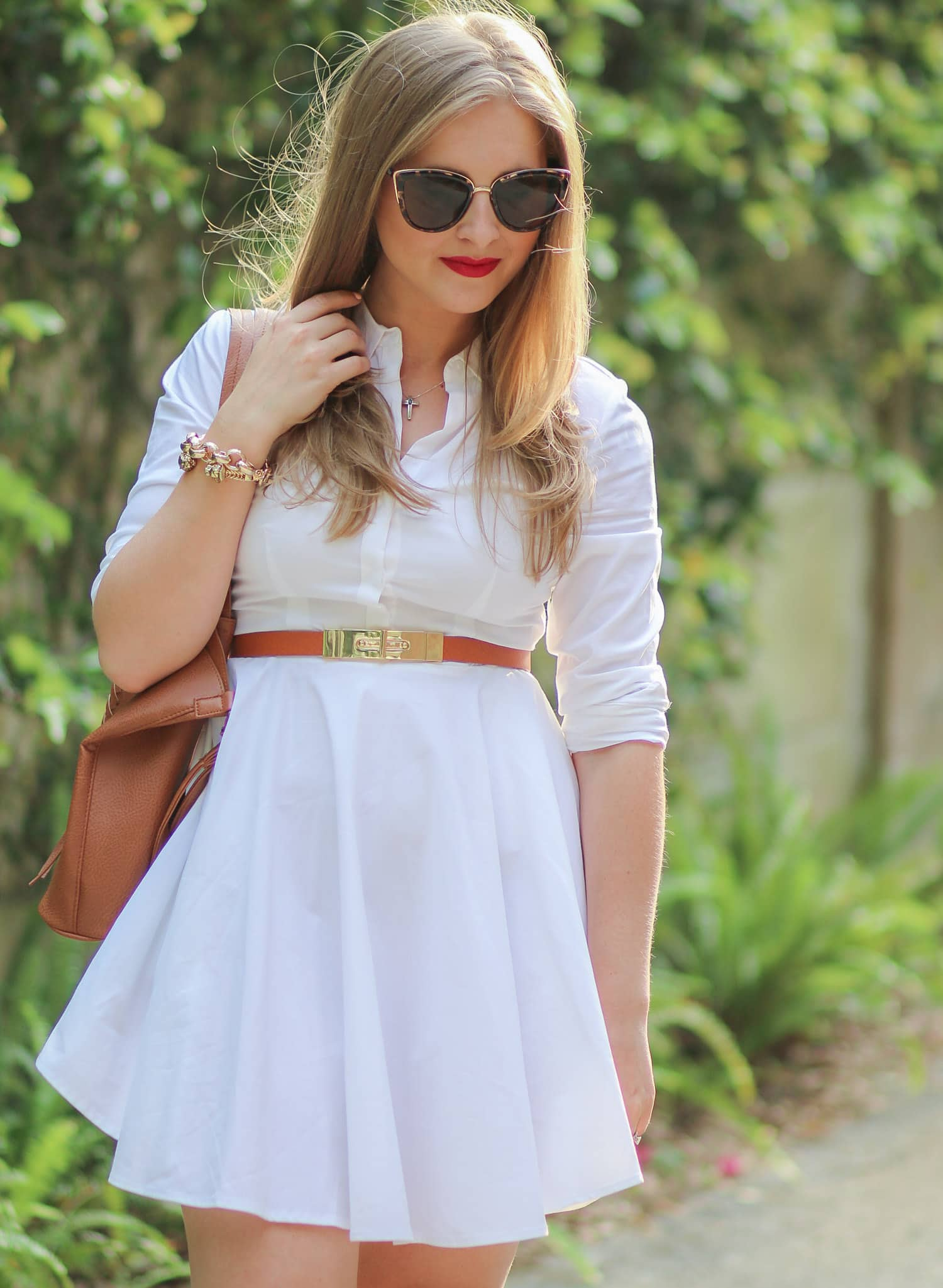 Every woman needs to own a white button-down collared dress. This cute Express dress is a classic closet staple that's perfect for work, dinner for friends, or even a date night! Click through this pin to see how Florida style blogger Ashley Brooke Nicholas styled this dress with a cognac and gold belt and the most beautiful gold lace-up heels from Banana Republic + learn how she got new hair for the season thanks to Hair Cuttery!   #MyHCLook sponsored by Hair Cuttery