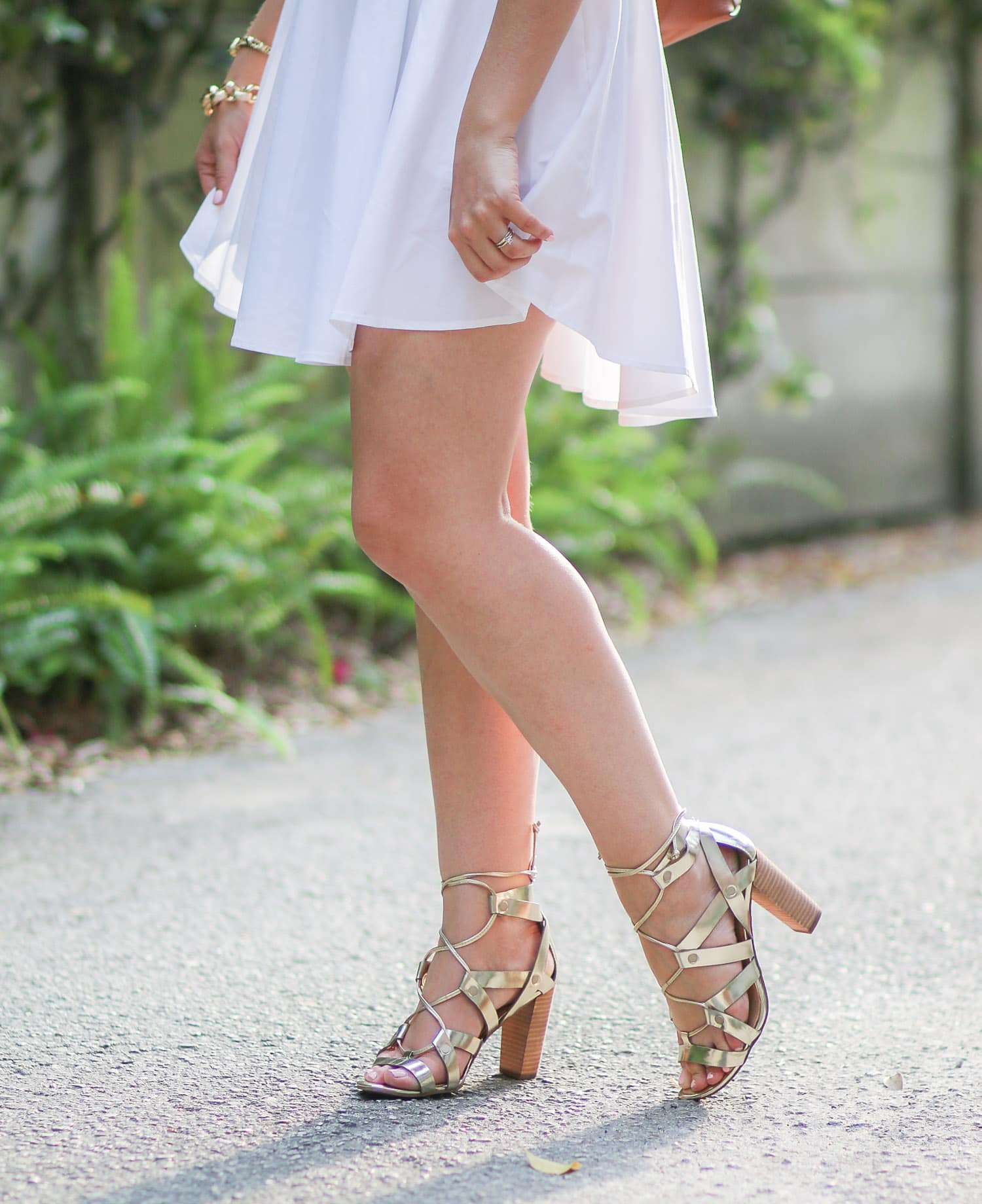 Every woman needs to own these shoes. Seriously, Banana Republic knocked it out of the park with these gorgeous gold lace-up heels. They're beautiful, but they're also extremely comfortable. I've worn them for 12 hours straight without blisters! Click through this pin to see how I styled these heels w/ an Express white button-down dress + learn how I got amazing new hair for the season thanks to my friends at Hair Cuttery!   by Ashley Brooke Nicholas #MyHCLook sponsored by Hair Cuttery