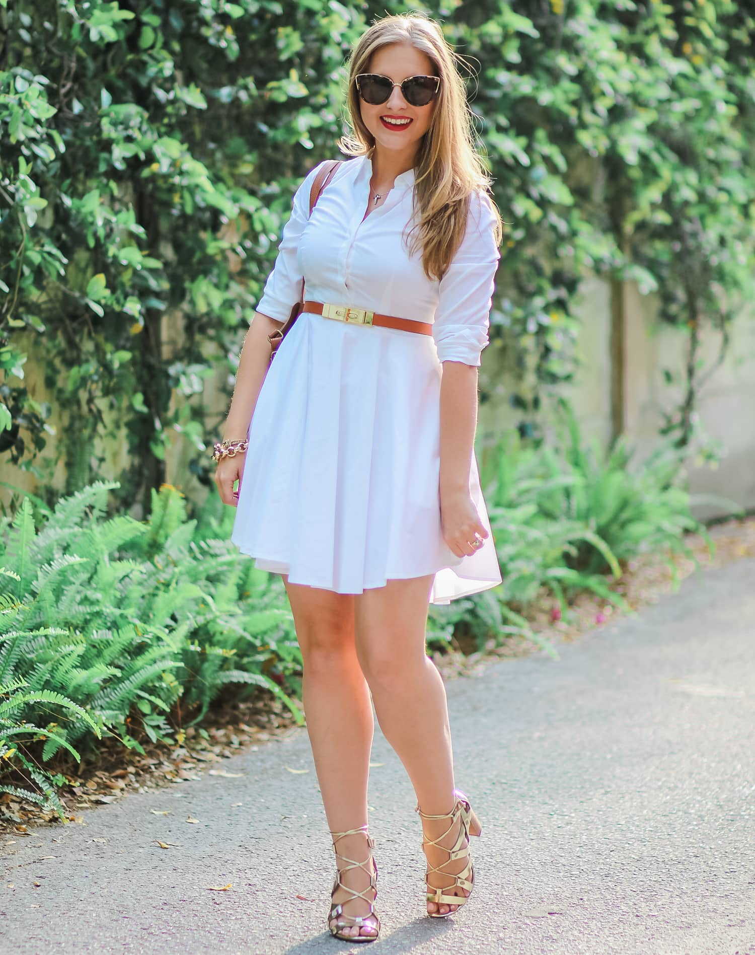 Classic white shirt dress from Express, gold lace-up sandals from Banana Republic, Quay My Girl tortoiseshell cat eye sunglasses, and cognac tote bag from Payless Shoesource styled by Florida fashion blogger Ashley Brooke Nicholas