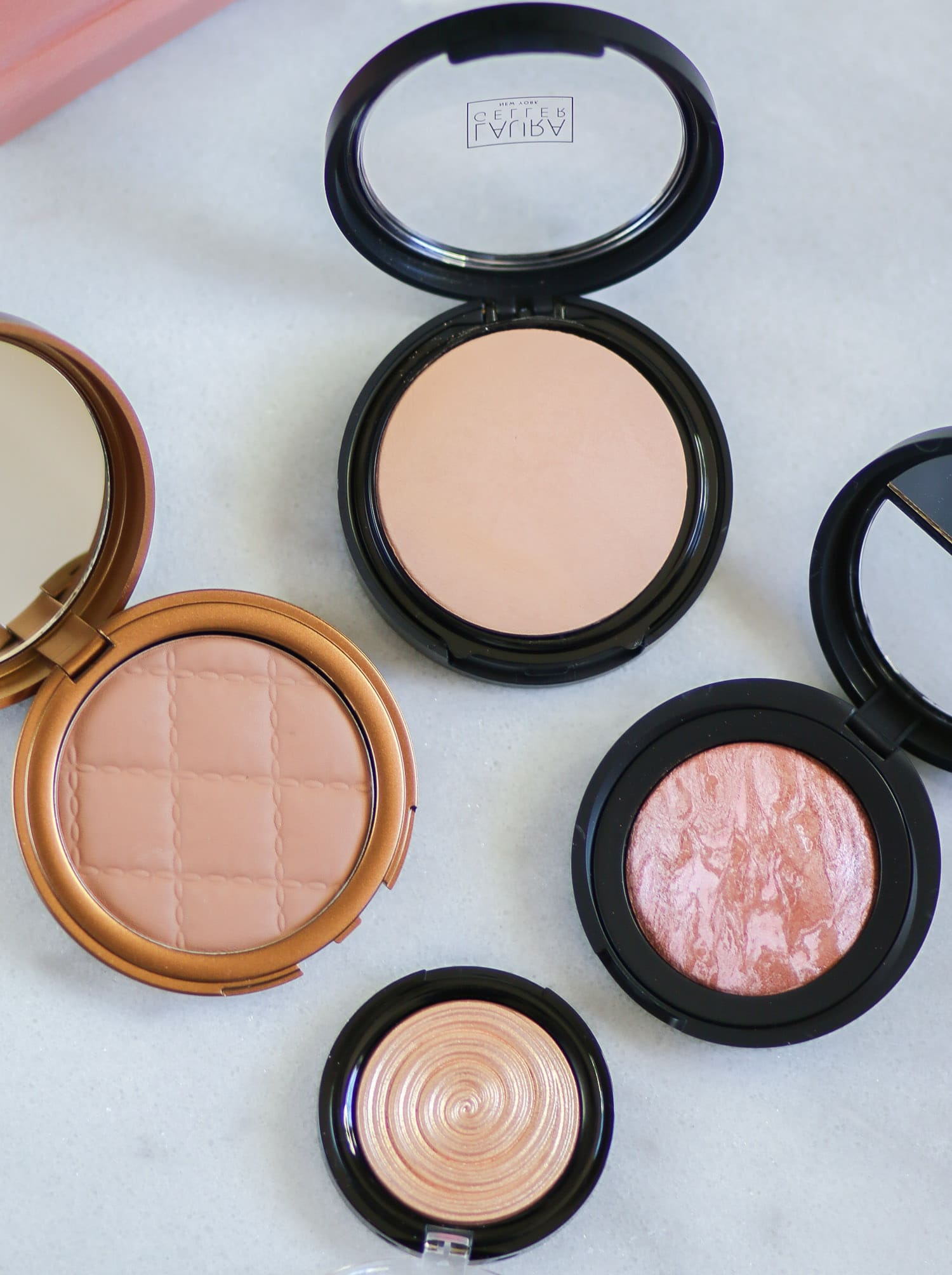 These Laura Geller face products are the bomb.com! The Beach Matte Baked Hydrating Bronzer is such a great matte bronzer for contouring, and the Laura Geller Baked Gelato Swirl Illuminator in Gilded Honey is heavenly. I also love the Baked Blush-n-Brighten in Honeysuckle for a bronze & pink summer glow, and the Double Take Baked Versatile Powder Foundation is incredible. Great coverage without a powdery finish! Click through to see a full review from blogger Ashley Brooke! @laurageller