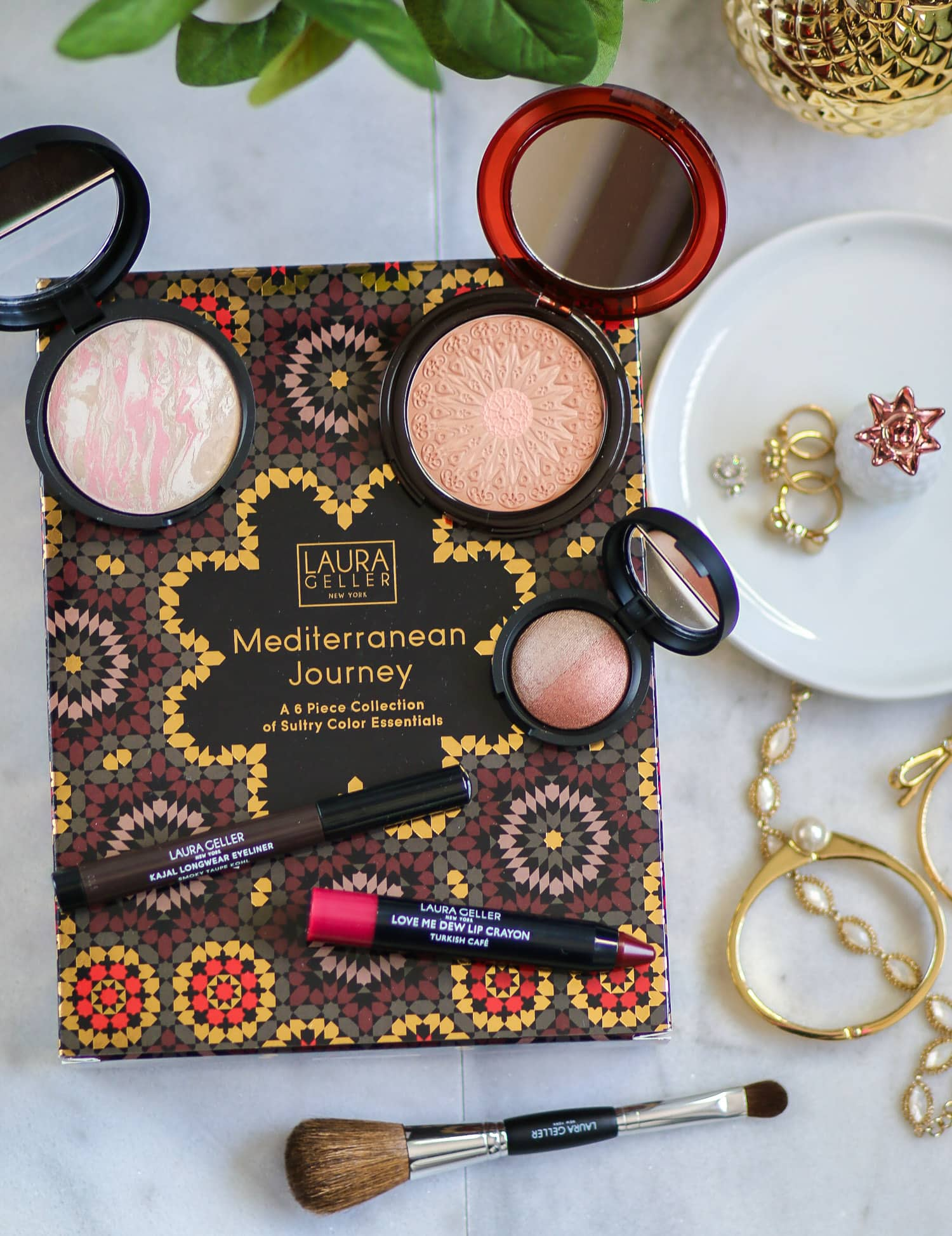 The Laura Geller Mediterranean Journey Collection is so beautiful! The kit includes Baked Balance-N-Brighten, Baked Mediterranean Bronzer in Moroccan Bronze, Baked Color Intense Shadow Duo in Stone/Terracotta, Kajal Eyeliner in Smokey Taupe Kohl, Love me Dew Lip Crayon in Turkish Cafe, brush & a tote. This set comes in 5 different color combinations for every skin tone from light to deep. Click through to see a full review from beauty blogger Ashley Brooke! @laurageller