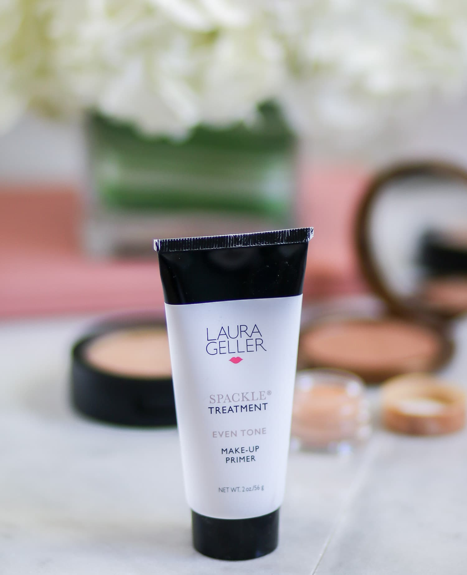 The Laura Geller Spackle Treatment Even Tone Makeup Primer is one of the best primers I've ever used. It has a peachy pink tone that instantly blurs imperfections, and the slightly tacky texture makes liquid or powder foundation last all day long! Plus, this primer has skincare ingredients to gradually even out your skin tone over time. Definitely a must-buy at @ultabeauty . Click through this pin to see a full review of @laurageller makeup from beauty blogger Ashley Brooke Nicholas!