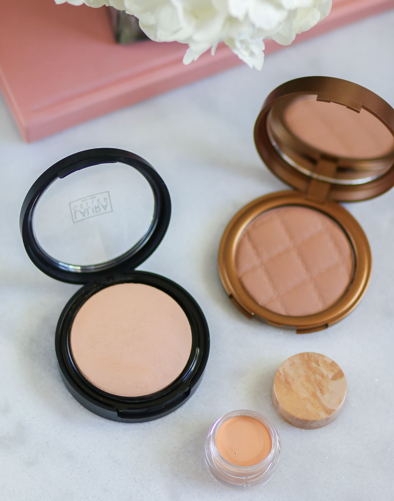 The Laura Geller Double Take Baked Versatile Powder Foundation is seriously incredible. You can use a brush to get light to medium coverage or a sponge to get a full-coverage finish WITHOUT a powdery finish. Even though it's a powder, the finished result looks like liquid foundation. You can also use it wet for a luminous full-coverage finish. Available in 9 shades at Ulta. Click through to see a full review of @laurageller from beauty blogger Ashley Brooke!