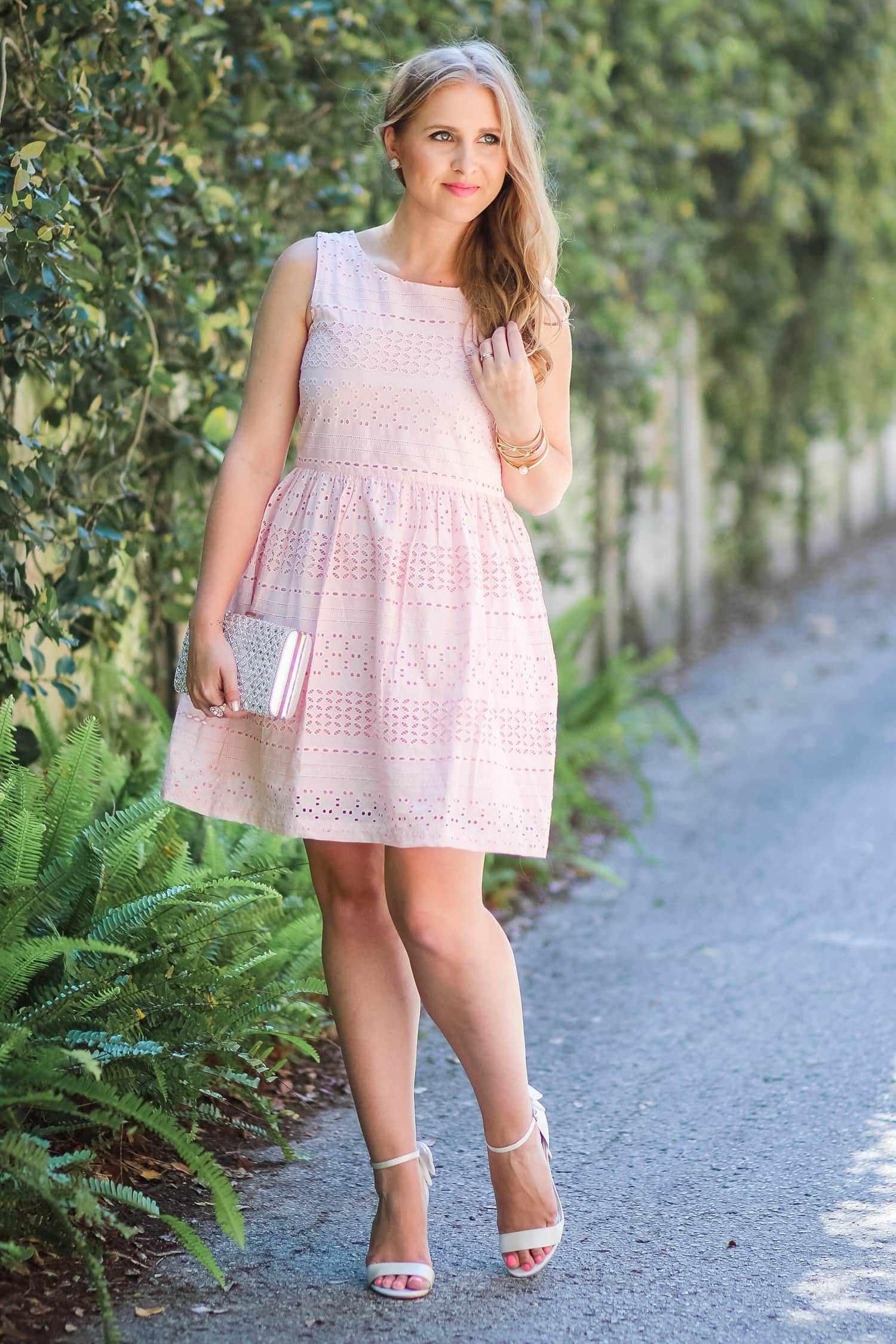 9a73a590430 This adorable peach eyelet tank dress is the perfect outfit idea for spring  or summer weddings