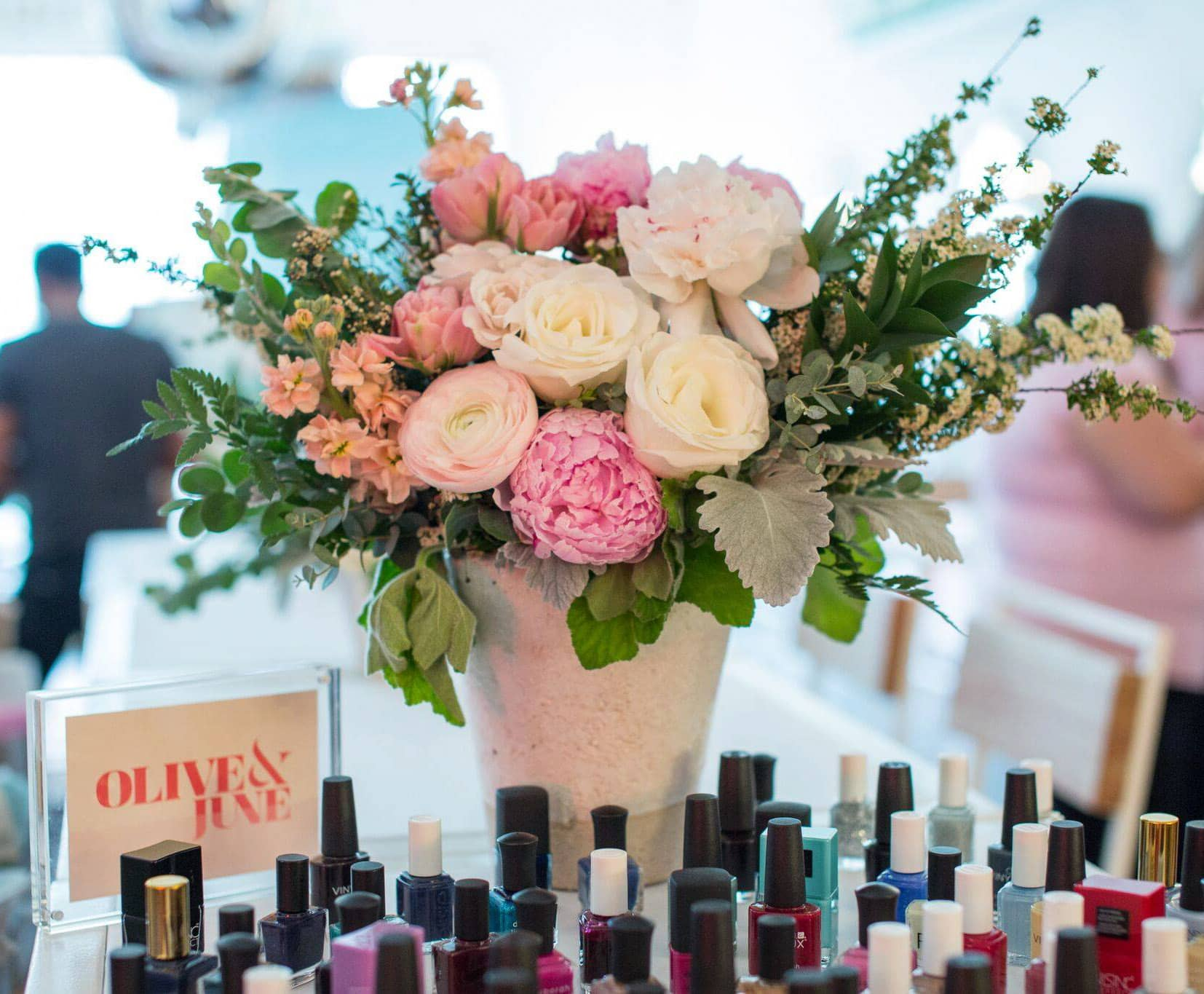 Olive & June display at Create + Cultivate Los Angeles 2016| Click through to read a full onference recap + review | Beauty and Style Blogger Ashley Brooke Nicholas