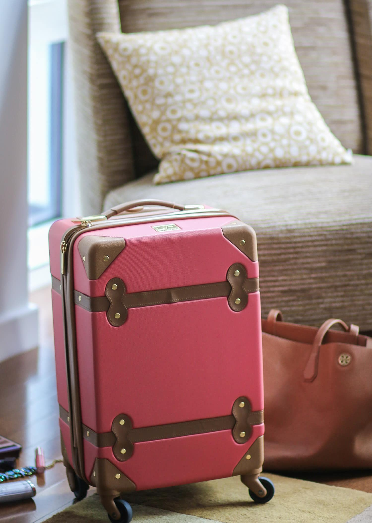 DVF Saluti Hardside Spinner luggage in coral might be the prettiest luggage piece of all time!