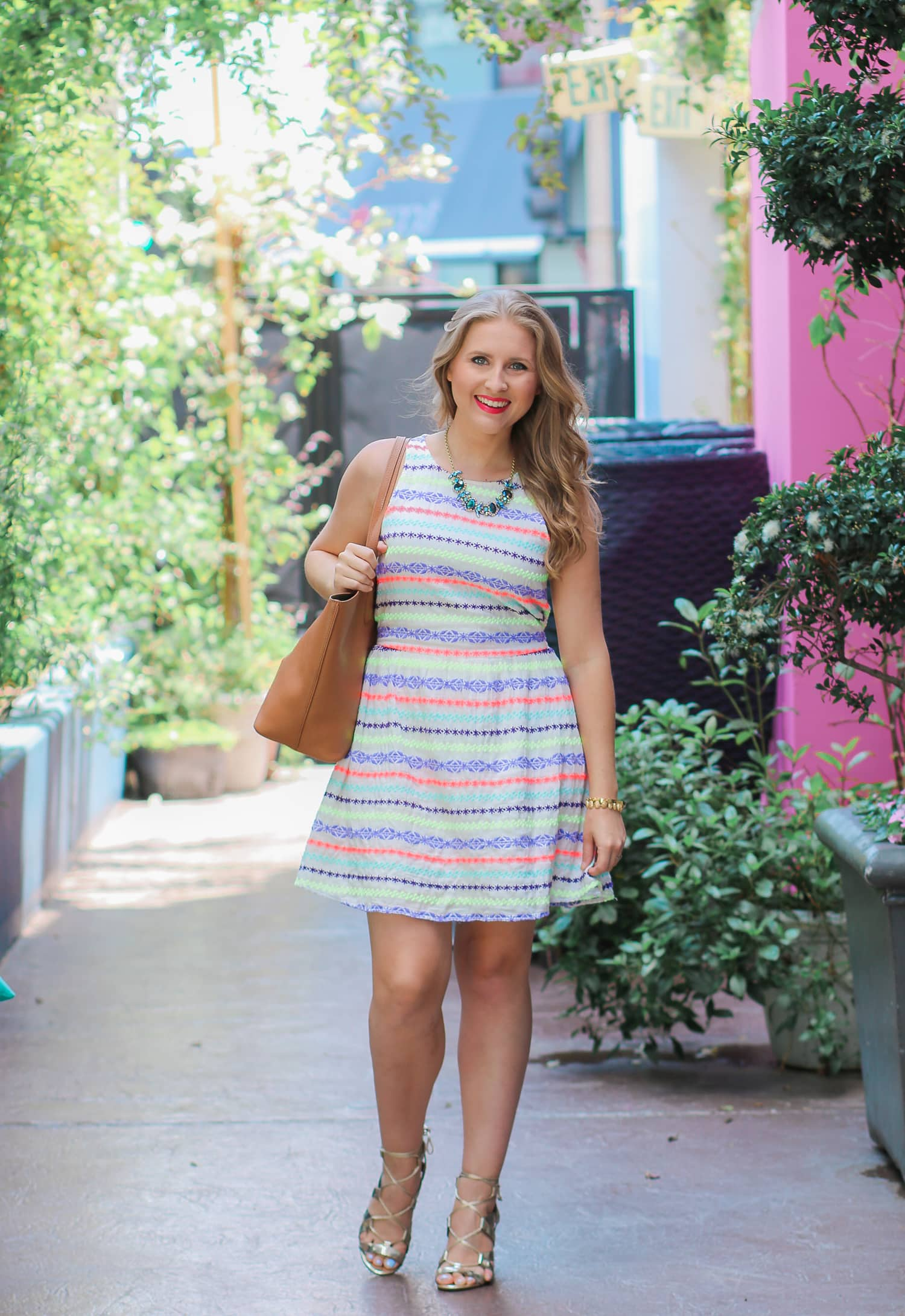 Looking for a cute summer dress that's flattering on a petite frame? Check out this neon striped fit-and-flare dress from the Target girls section. Even though it's a girls' item, it fits petite women who are a size 2-4 perfectly! See the dress styled by fashion blogger Ashley Brooke Nicholas in today's post at the beautiful Esterel restaurant at the Sofitel Los Angeles Beverly Hills hotel.
