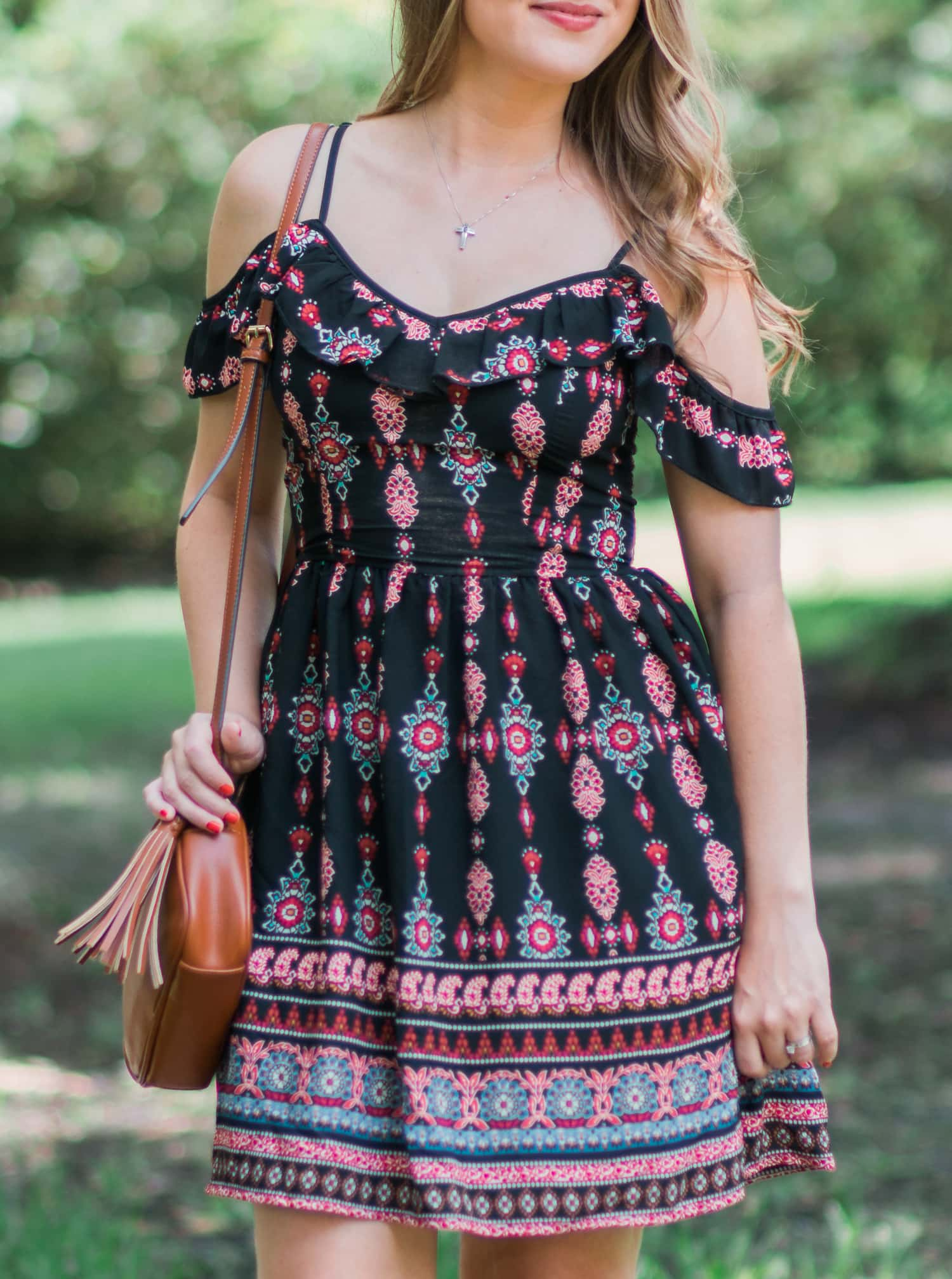 A girl can never own too many dresses- especially in the summertime! My go-to summer date night look is an off-the-shoulder sundress with cognac lace-up heels and soft curls. In addition to being a cute summer outfit idea, it's also extremely affordable. Everything in this look is under $40! Click through this pin to see the full look from Ashley Brooke Nicholas! | #MyHCLook sponsored by Hair Cuttery