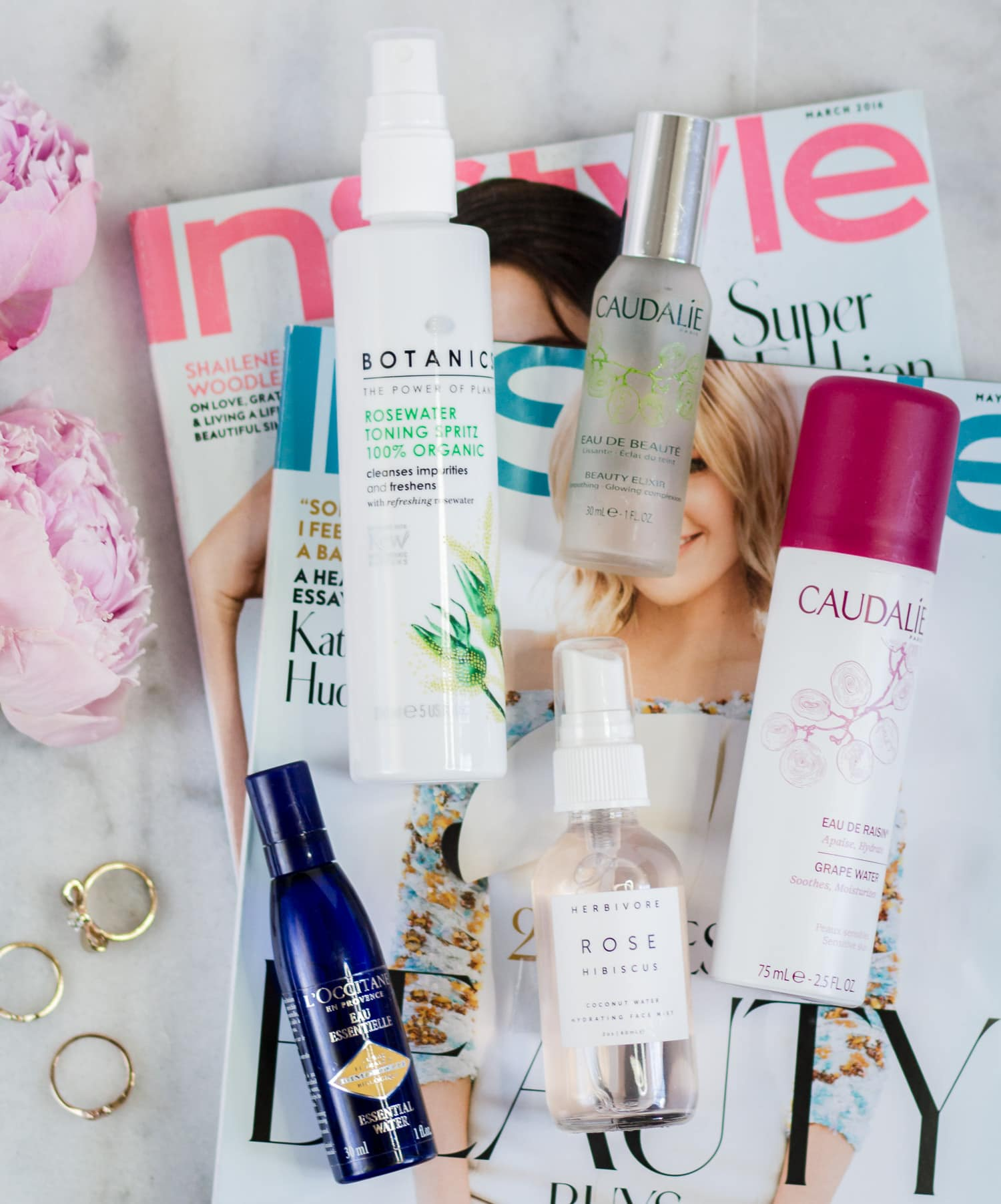 The best new skincare products for women in their 20s - including the best facial mists + a review of Boots Botanics Organic Rosewater Toning Spritz, Caudalie Beauty Elixir, Caudalie Grape Water, Herbivore Rose Hibiscus Coconut Water Hydrating Face Mist, and L'Occitane Immortelle Essential Water by beauty blogger Ashley Brooke Nicholas