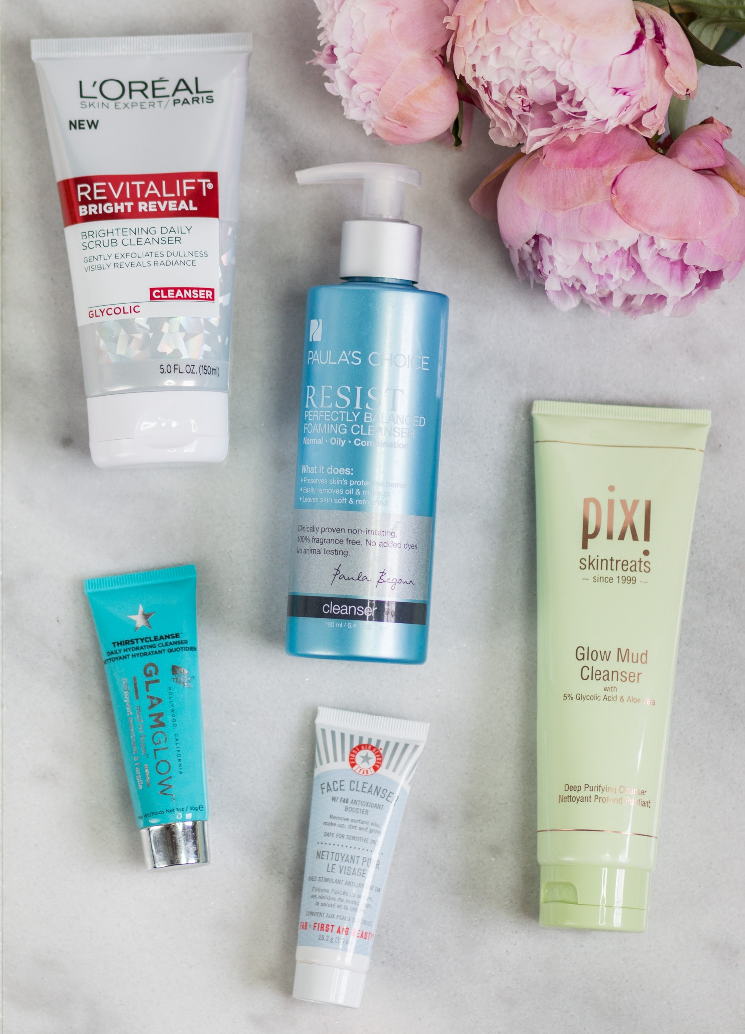 The best new skincare products for women in their 20s - including the best cleansers + a review of L'ORÉAL Revitalift Bright Reveal Cleanser, Paula's Choice Resist Perfectly Balanced Foaming Cleanser, Pixi Glow Mud Cleanser, GLAMGLOW ThirstyCleanse Daily Hydrating Cleanser, and First Aid Beauty Face Cleanser by beauty blogger Ashley Brooke Nicholas