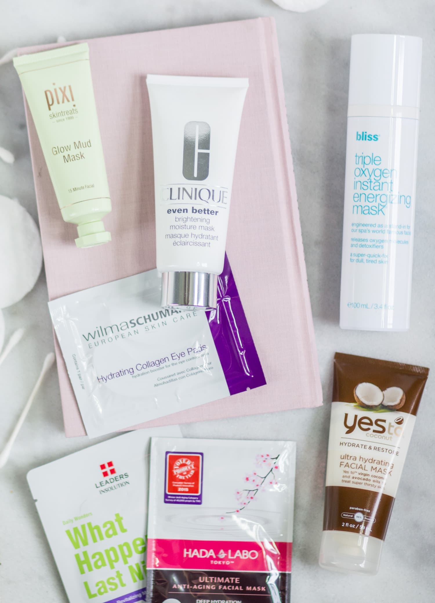 The best new skincare products for women in their 20s - including the best face masks, sheet masks, and hydrogel eye masks + a review of Pixi Glow Mud Mask, 100% Pure Bright Eyes Mask, Clinique Even Better Brightening Moisture Mask, Bliss Triple Oxygen Instant Energizing Mask, Yes to Coconut Ultra Hydrating Facial Mask, Wilma Schuman Hydrating Collagen Eye Pads, LEADERS Daily Wonders What Happened Last Night Revitalizing Mask, Hada Labo Tokyo Ultimate Anti-Aging Facial Mask, 100% Pure Ginseng Collagen Boost Mask and Green Tea Water Bomb Mask by beauty blogger Ashley Brooke Nicholas