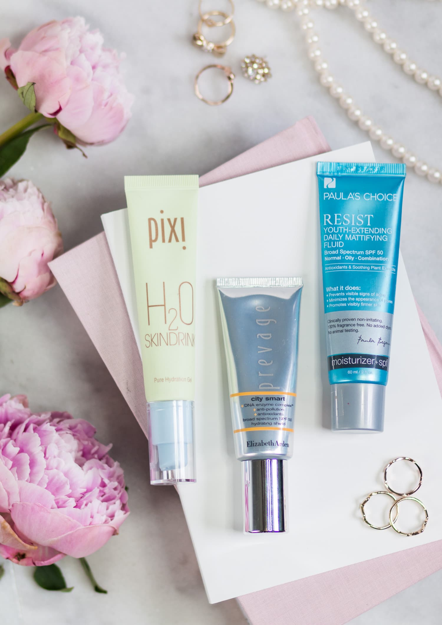 The best new skincare products for women in their 20s - including the best anti-aging moisturizers + a review of Pixi H2O Skindrink Pure Hydration Gel, Elizabeth Arden Prevage City Smart Broad Spectrum SPF 50 Hydrating Shield, and Paula's Choice Resist Youth-Extending Daily Mattifying Fluid by beauty blogger Ashley Brooke Nicholas