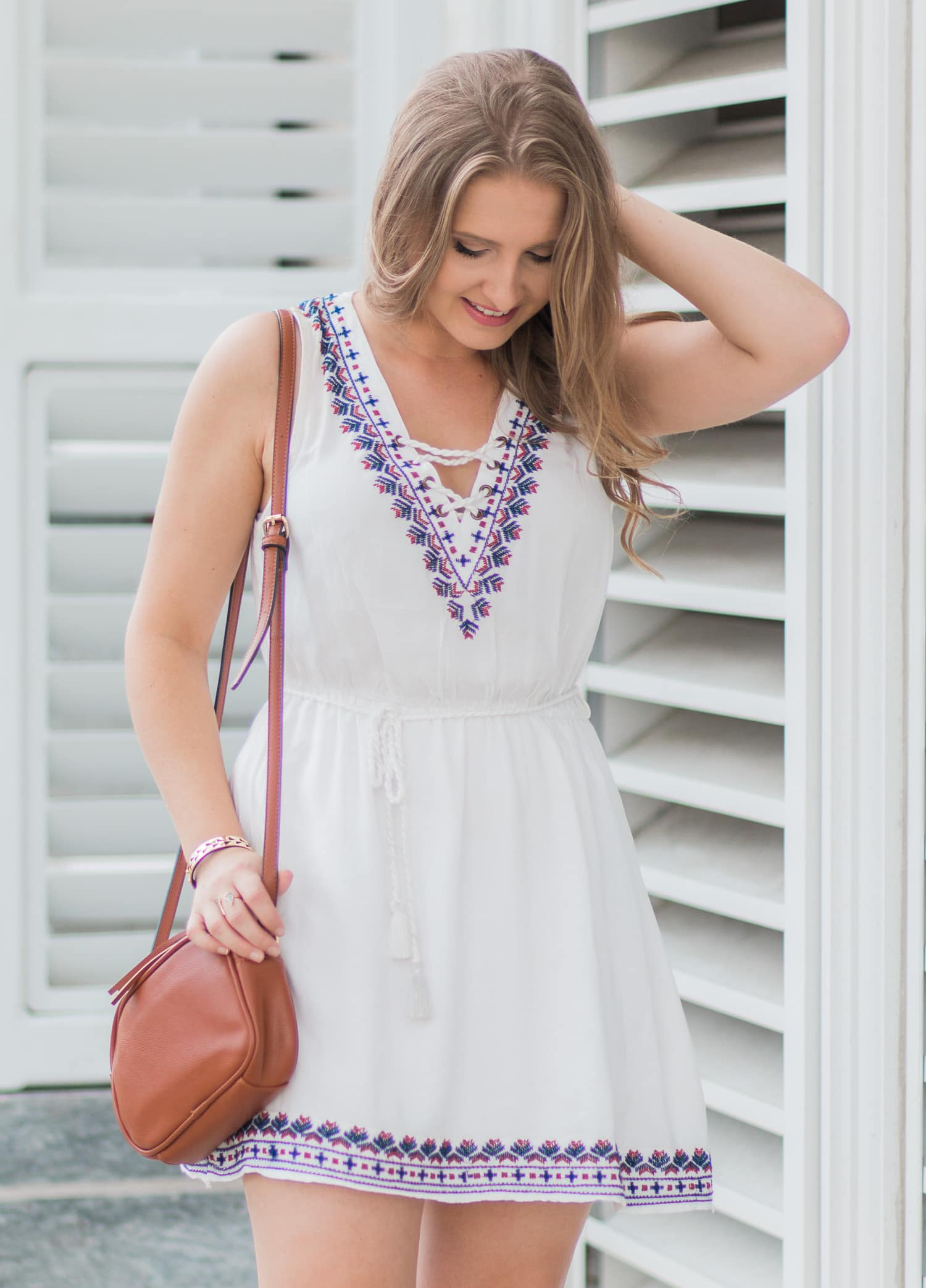 Forever 21 white embroidered lace-up dress outfit idea from blogger Ashley Brooke Nicholas