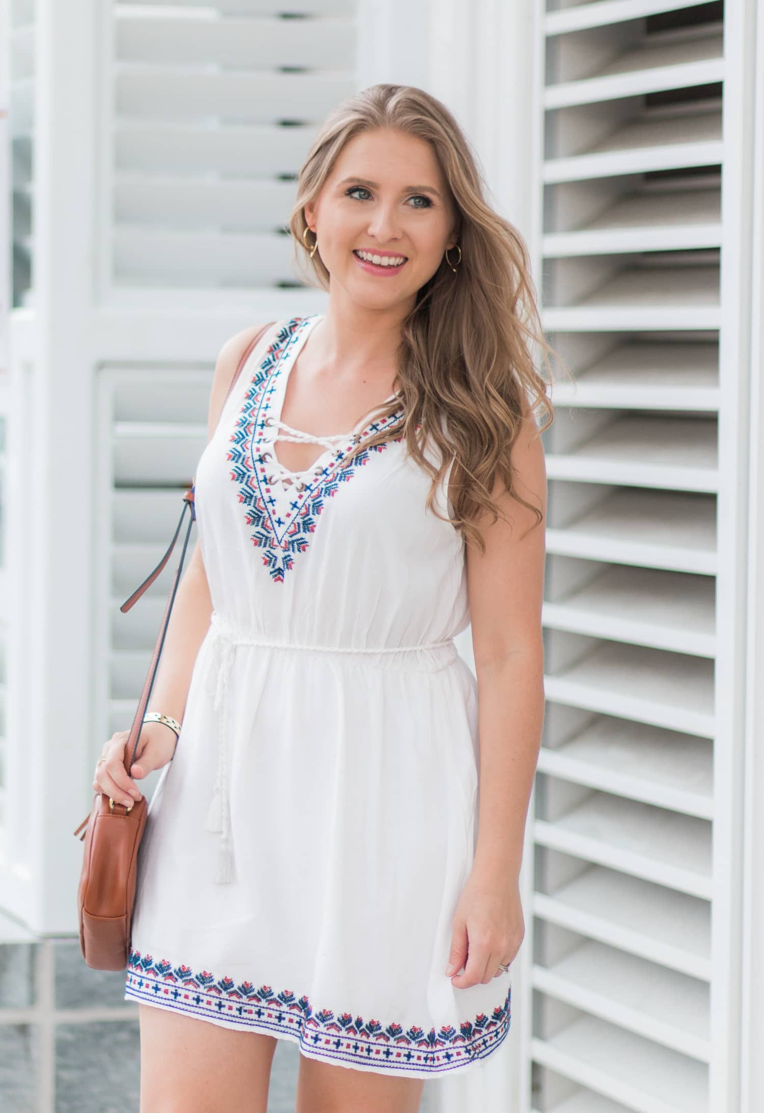 Forever 21 embroidered lace-up dress, Old Navy cognac tassel crossbody bag, and Stella & Dot Addison cuff and Winding Arrow earrings | Ashley Brooke Nicholas