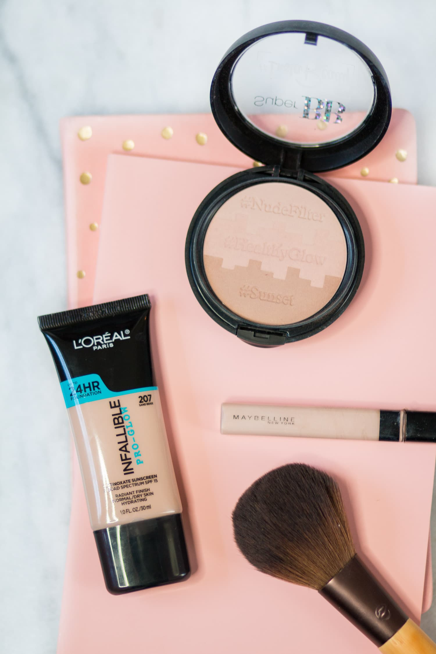 L'Oreal Pro Glow foundation, Maybelline Fit Me concealer, Physicians Formula BB Nude Filter Powder, EcoTools powder brush | Easy pumpkin spice makeup tutorial featuring all drugstore makeup by beauty blogger Ashley Brooke Nicholas