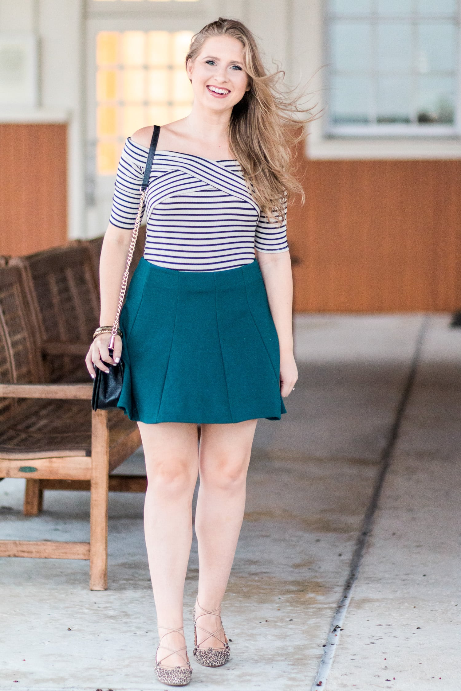 Striped off-the-shoulder top, hunter green skater skirt, Lucky Brand Aviee leopard print lace-up ballet flats. Click through this image to see this cute fall outfit idea by style blogger Ashley Brooke Nicholas.
