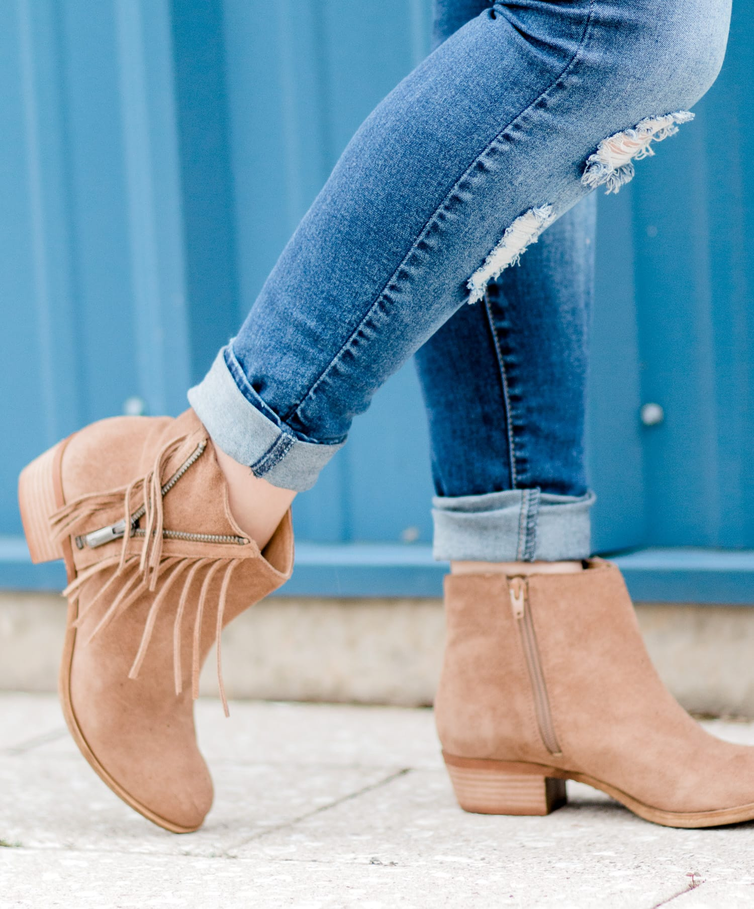 Lucky Brand Beeliner fringe booties with destroyed denim jeans styled by blogger Ashley Brooke Nicholas.