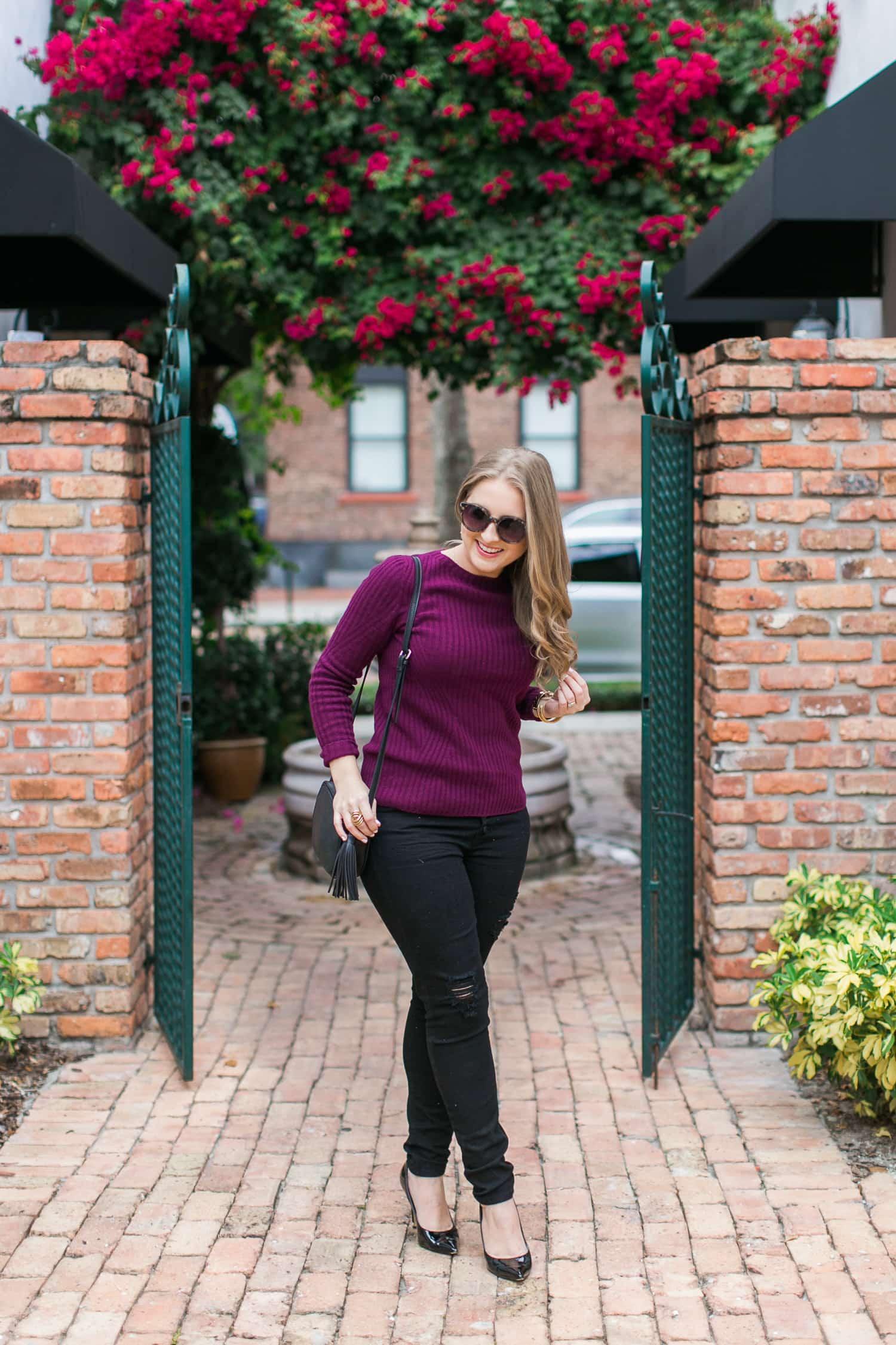 black-ripped-jeans-retro-round-sunglasses-burgundy-cashmere-sweater-black-pointy-toe-pumps-tassel-handbag-001
