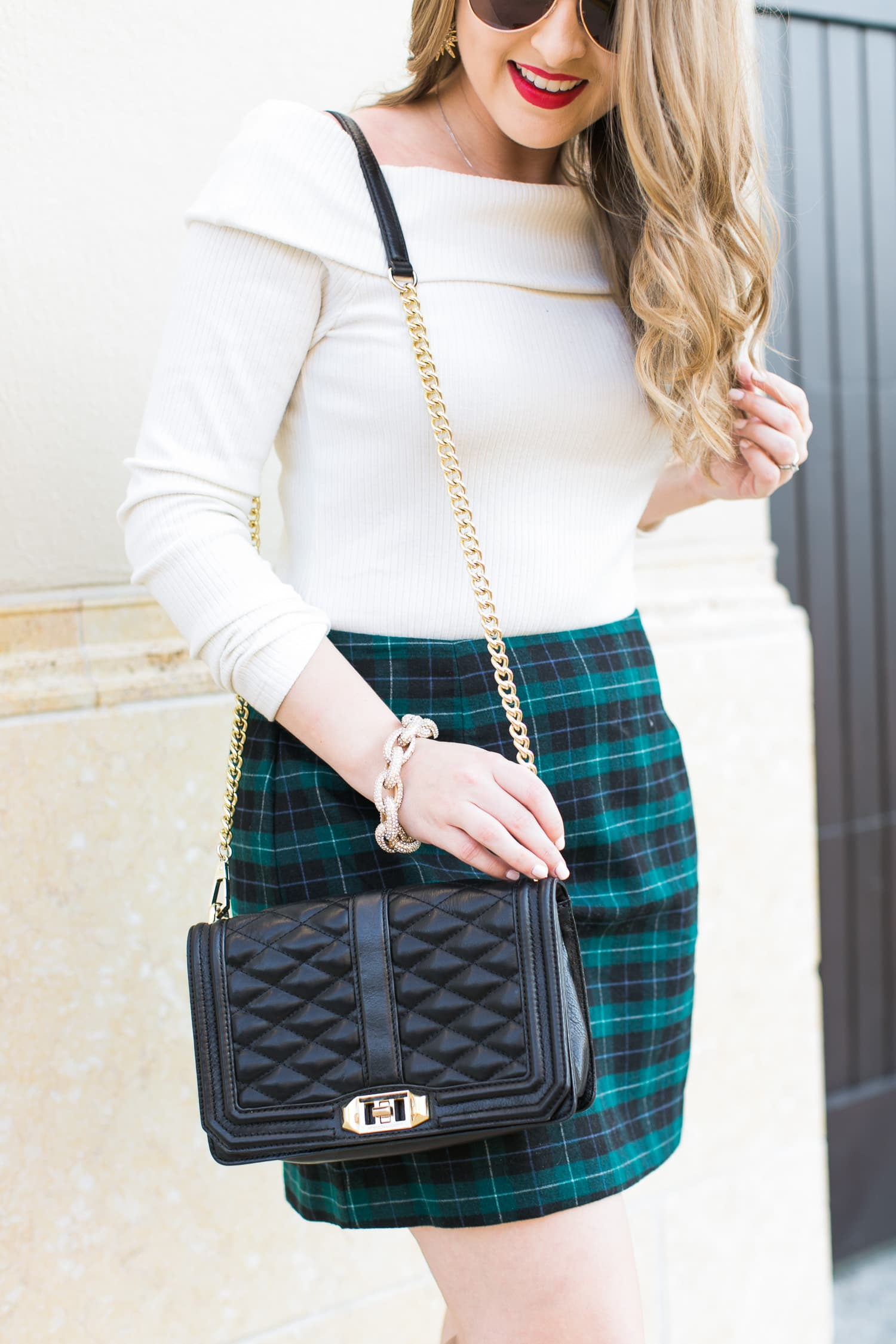 holiday-party-outfit-idea-off-shoulder-sweater-plaid-skirt-red-lips-pave-link-bracelet-rebecca-minkoff-purse-015