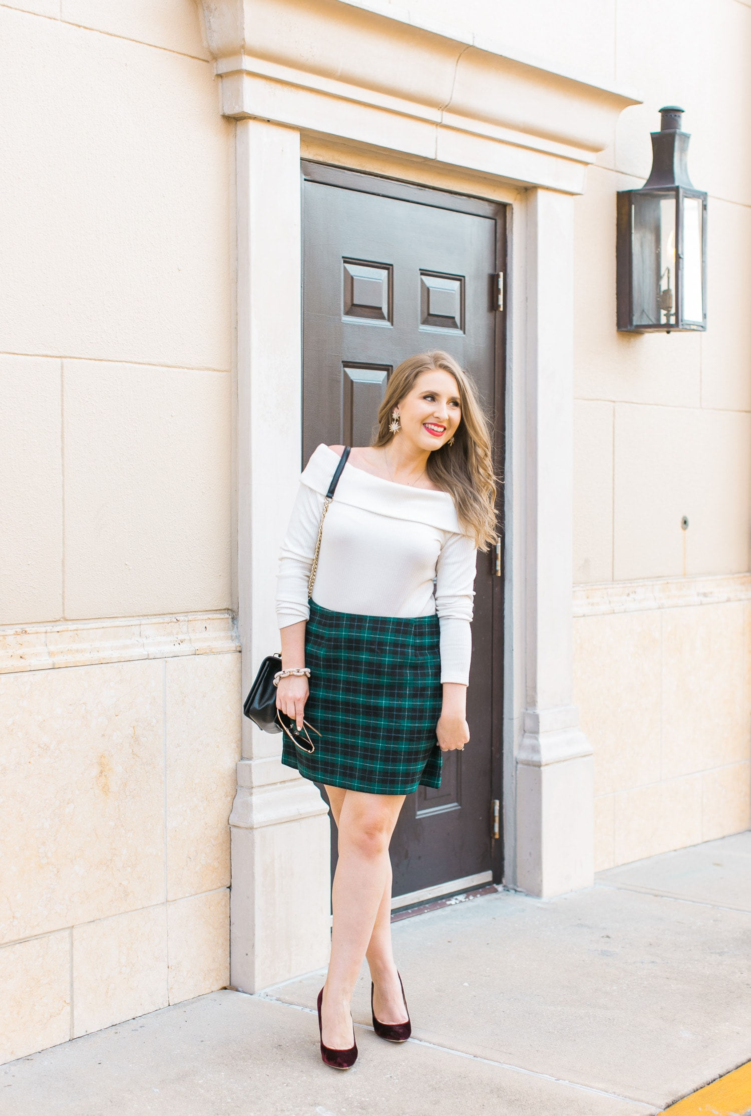 holiday-party-outfit-idea-off-shoulder-sweater-plaid-skirt-velvet-heels-002