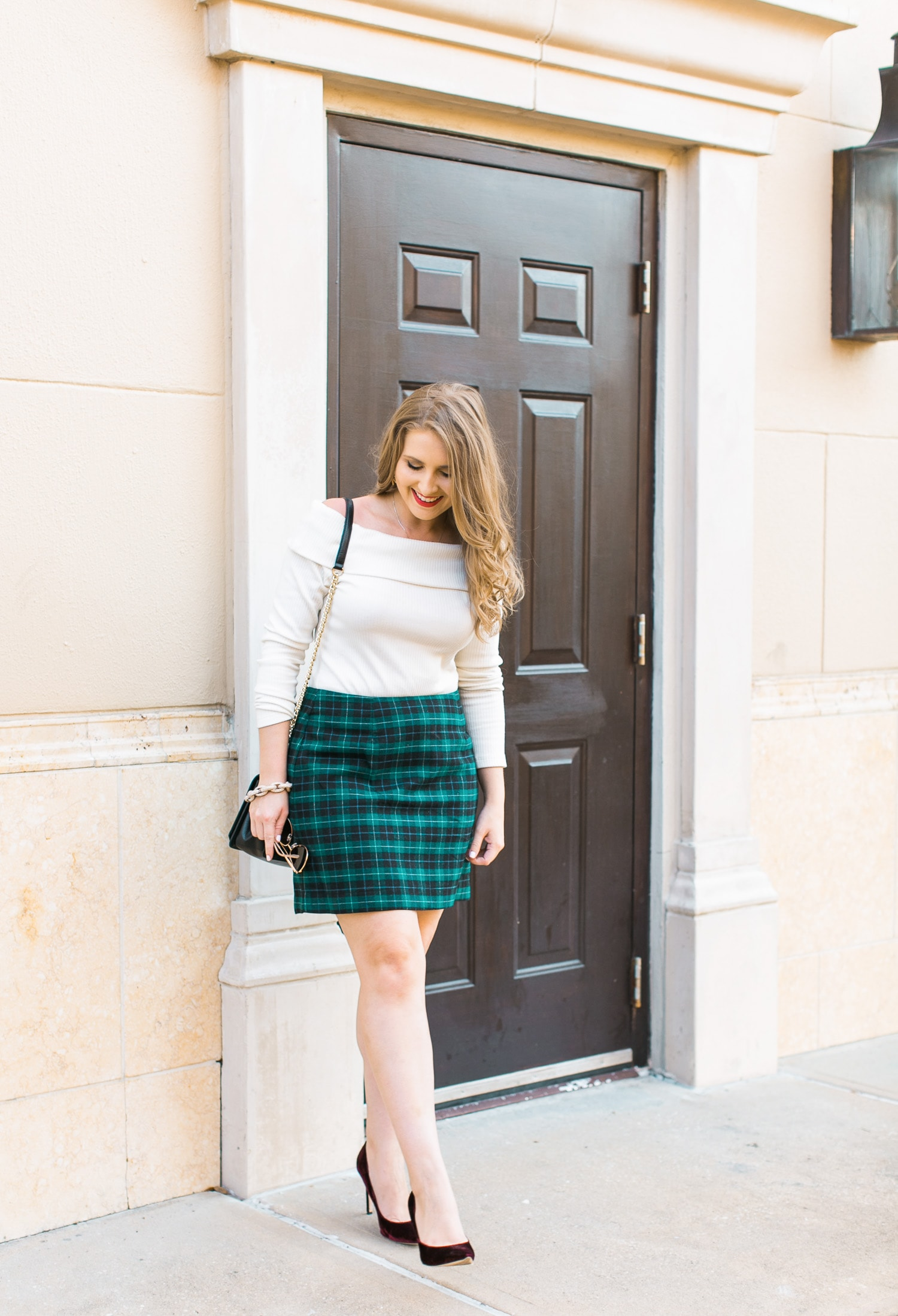 holiday-party-outfit-idea-off-shoulder-sweater-plaid-skirt-velvet-heels-2