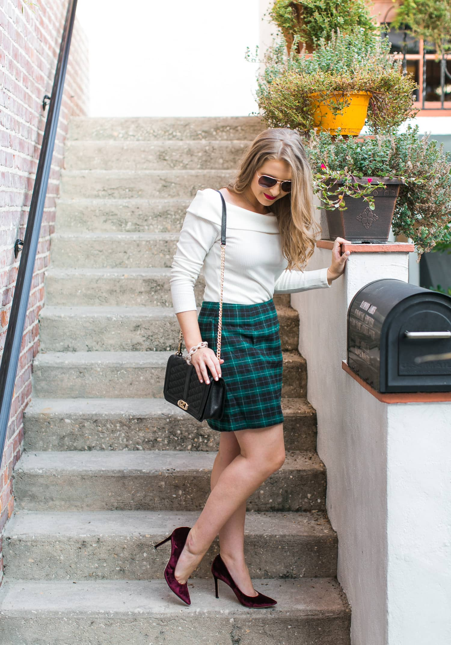 preppy-christmas-party-outfit-idea-off-shoulder-sweater-plaid-skirt-velvet-pumps-rose-gold-aviator-sunglasses-foster-grant-021