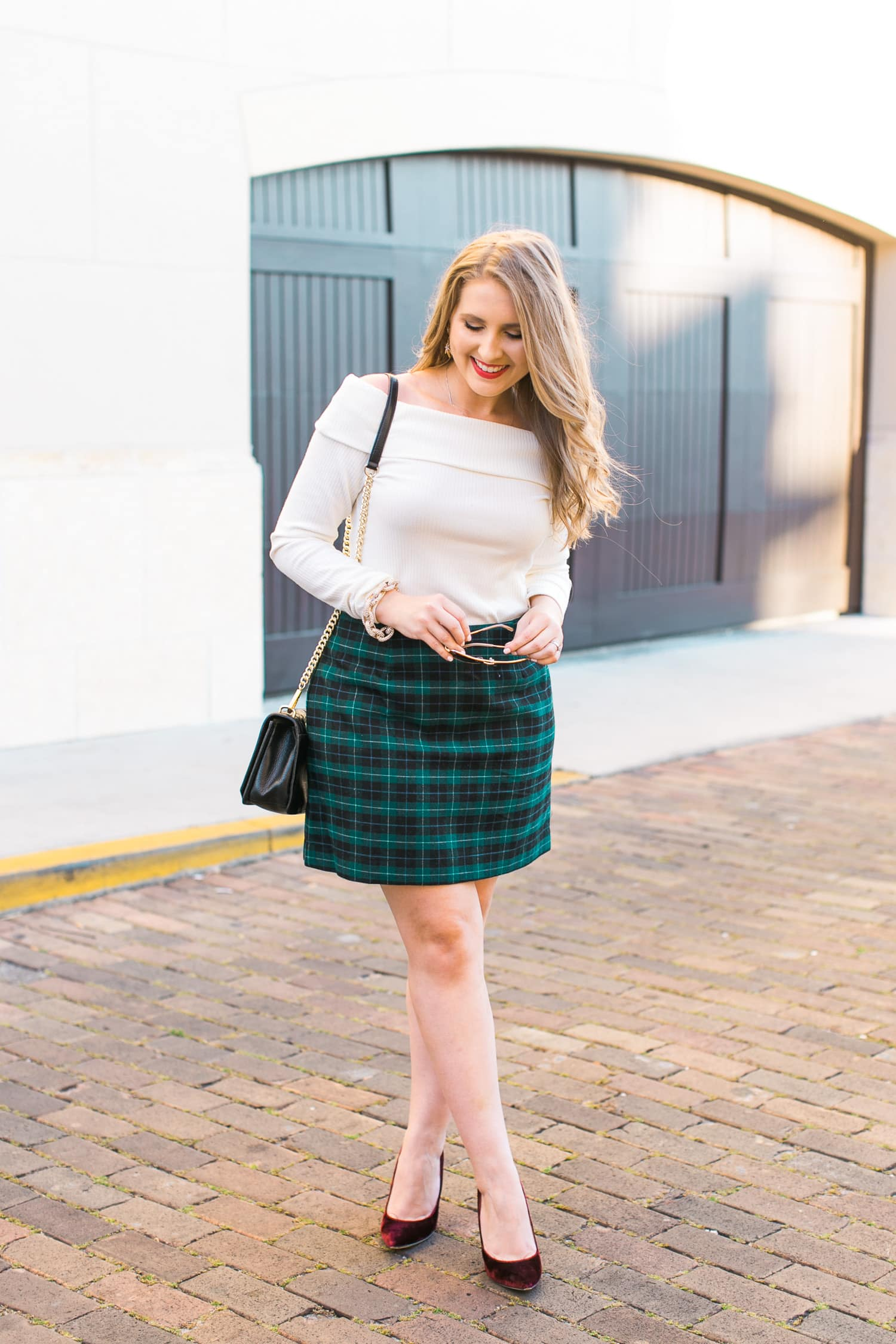 preppy-christmas-party-outfit-idea-plaid-skirt-off-shoulder-sweater-velvet-pumps-foster-grant-aviator-sunglasses-033