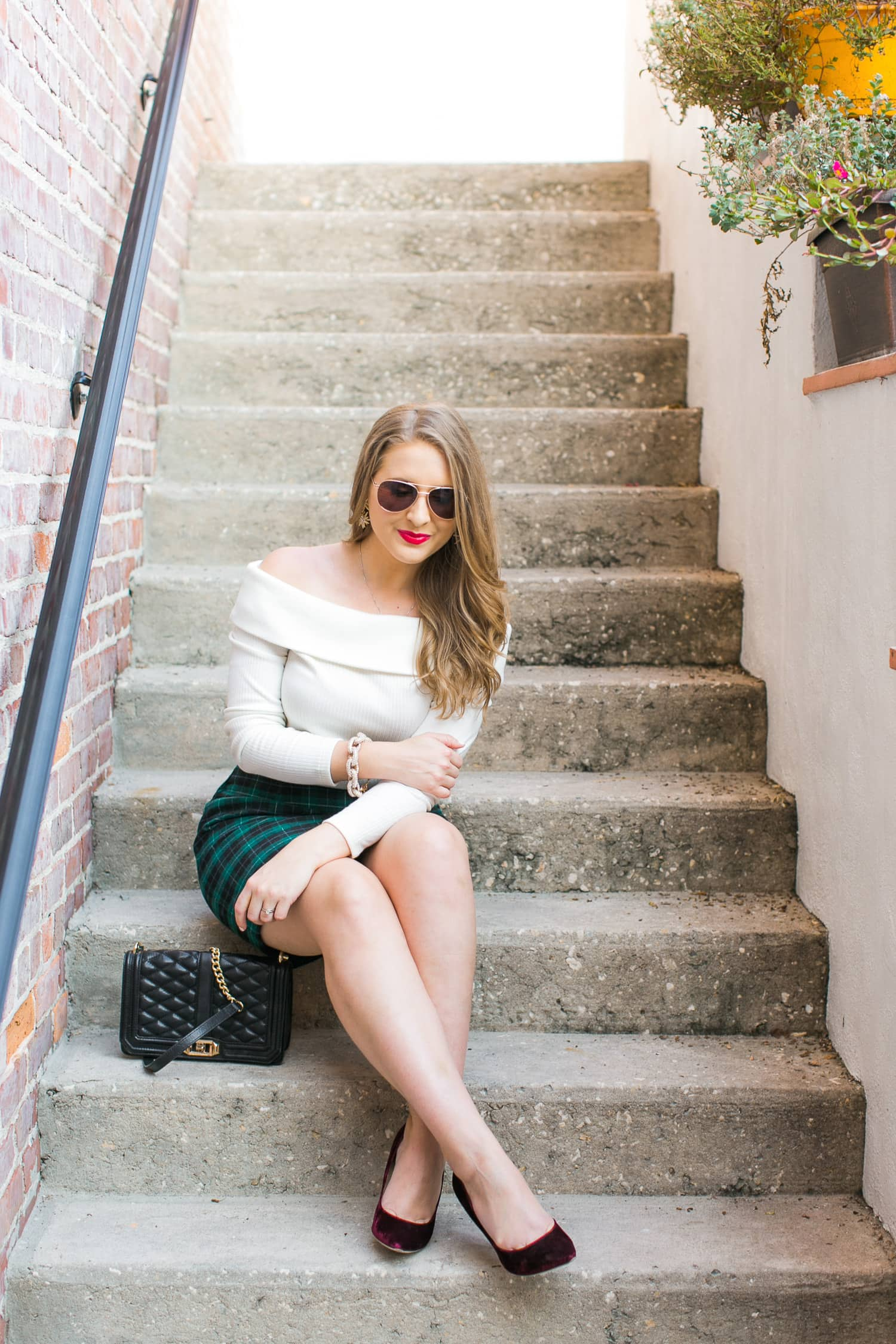 preppy-christmas-party-outfit-idea-rose-gold-foster-grant-sunglasses-velvet-pumps-off-shoulder-sweater-plaid-skirt-002