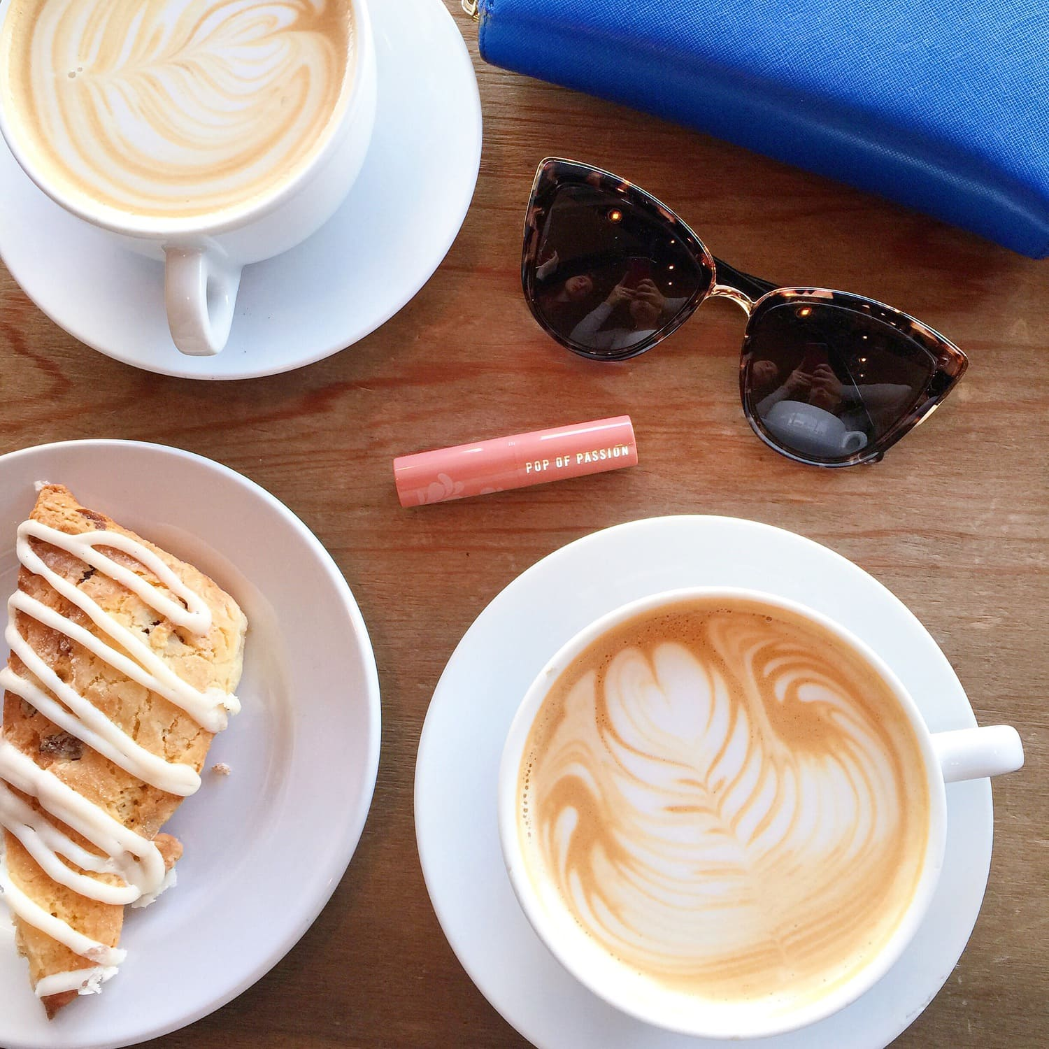 Pretty Latte Art, Frosted Scone, Pink Lip Balm, and Tortoise Shell Cat Eye Sunglasses at Buddy Brew Coffee in Tampa | Tampa Florida Travel Guide | Marry Me on A Megabus Giveaway | Affordable Travel Options | Florida Travel Blogger Ashley Brooke Nicholas |