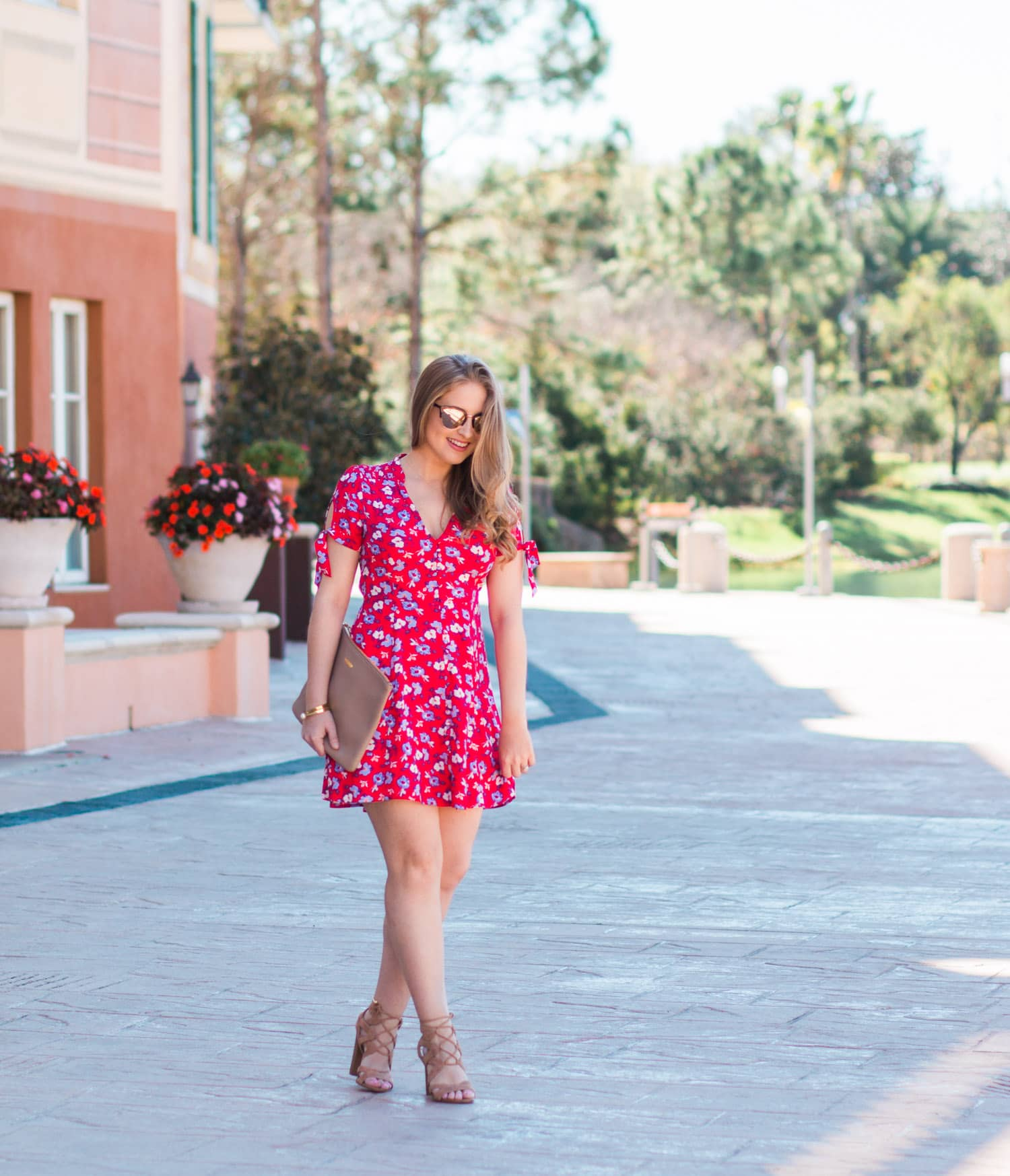 Portofino Bay Hotel woman Walking Floral Dress Sun