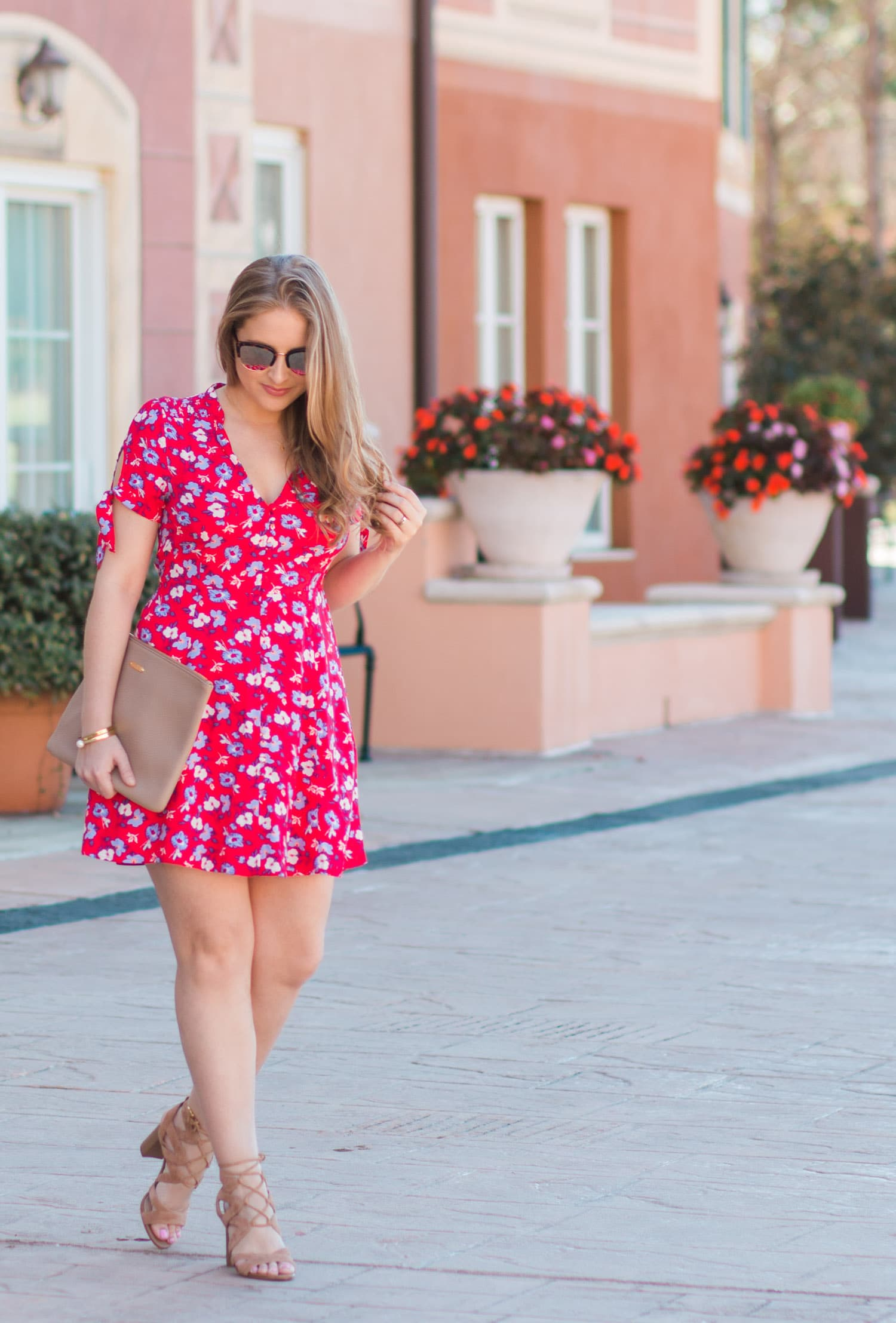 woman walking red floral dress