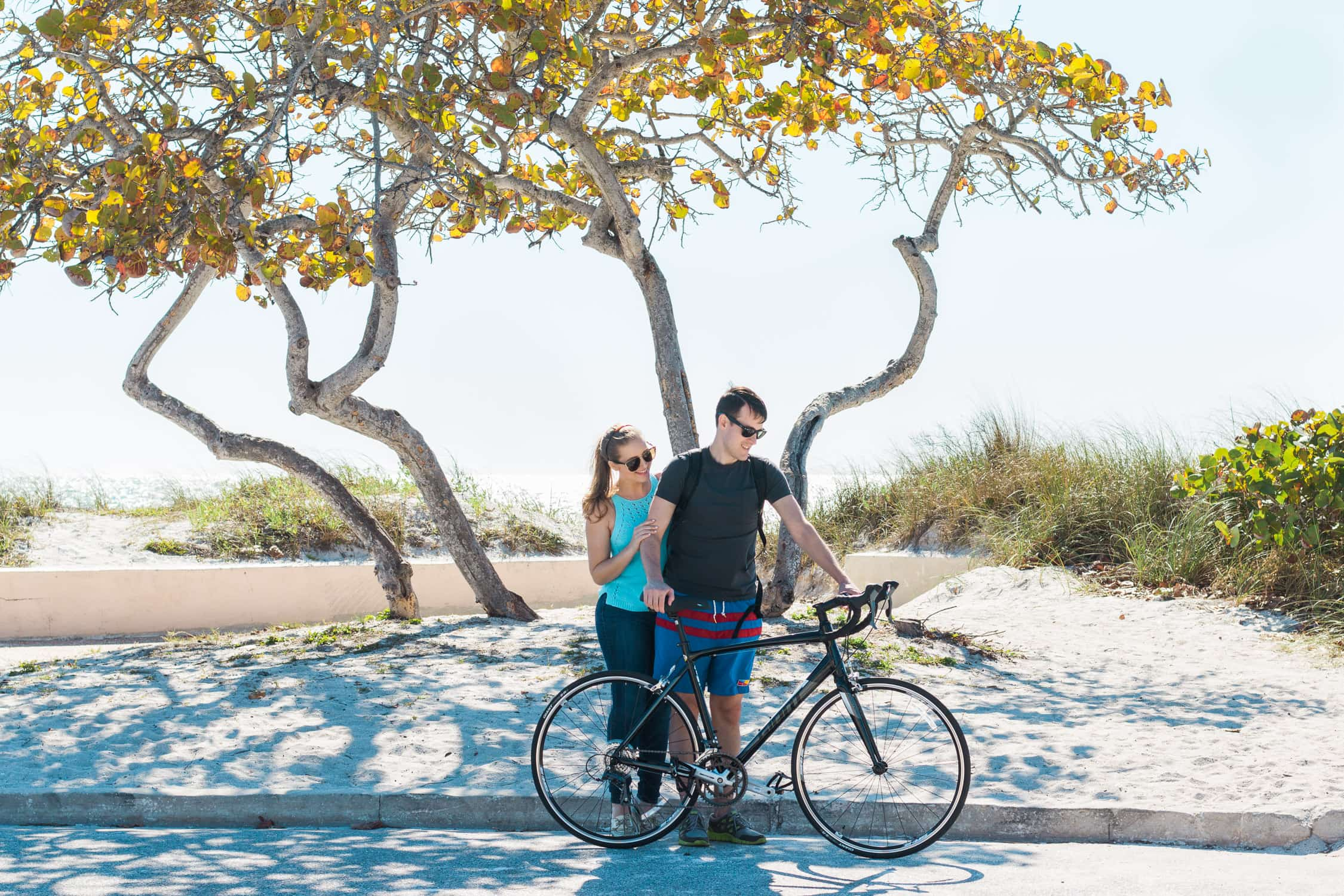 Couples bike ride on Lido Beach | How to plan an adventurous weekend getaway in Longboat Key, Florida including a day of boating! #LoveFL sponsored by @visitflorida | Florida travel tips, beach vacation, vacation ideas, vacation goals, travel blogger Ashley Brooke Nicholas, Florida travel guide, Longboat Key travel guide, Sarasota travel guide, beautiful beaches, boating, affordable travel, US travel, summer vacation, spring break ideas