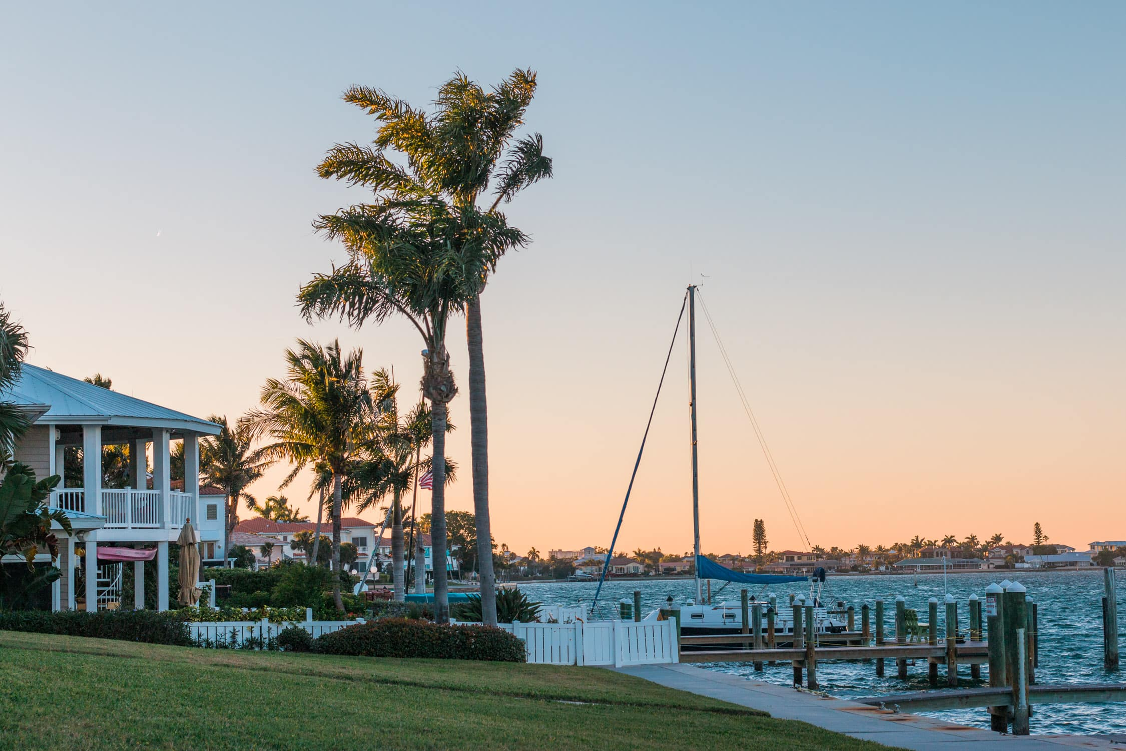 How to plan a romantic weekend getaway in Longboat Key, Florida, including a relaxing stay at The Resort at Longboat Key Club! #LoveFL sponsored by @visitflorida | sunset dinner on the water at Dry Dock Waterfront Grill | Florida travel tips, beach vacation, vacation ideas, vacation goals, travel blogger Ashley Brooke Nicholas, Florida travel guide, Longboat Key travel guide, Sarasota travel guide, beautiful beaches, boating, affordable travel, US travel, summer vacation, spring break ideas, romantic vacation