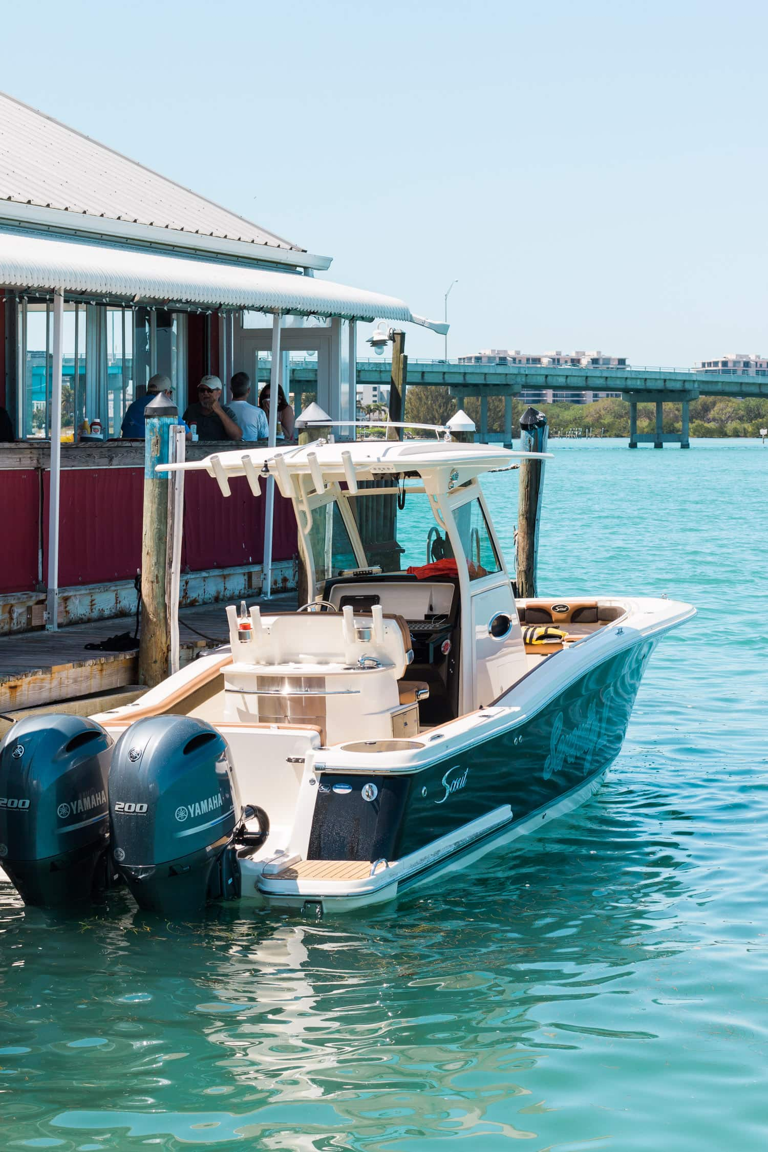 Ride your boat to lunch at The Old Salty Dog restaurant in Longboat Key | How to plan an adventurous weekend getaway in Longboat Key, Florida including a day of boating! #LoveFL sponsored by @visitflorida | Florida travel tips, beach vacation, vacation ideas, vacation goals, travel blogger Ashley Brooke Nicholas, Florida travel guide, Longboat Key travel guide, Sarasota travel guide, beautiful beaches, boating, affordable travel, US travel, summer vacation, spring break ideas