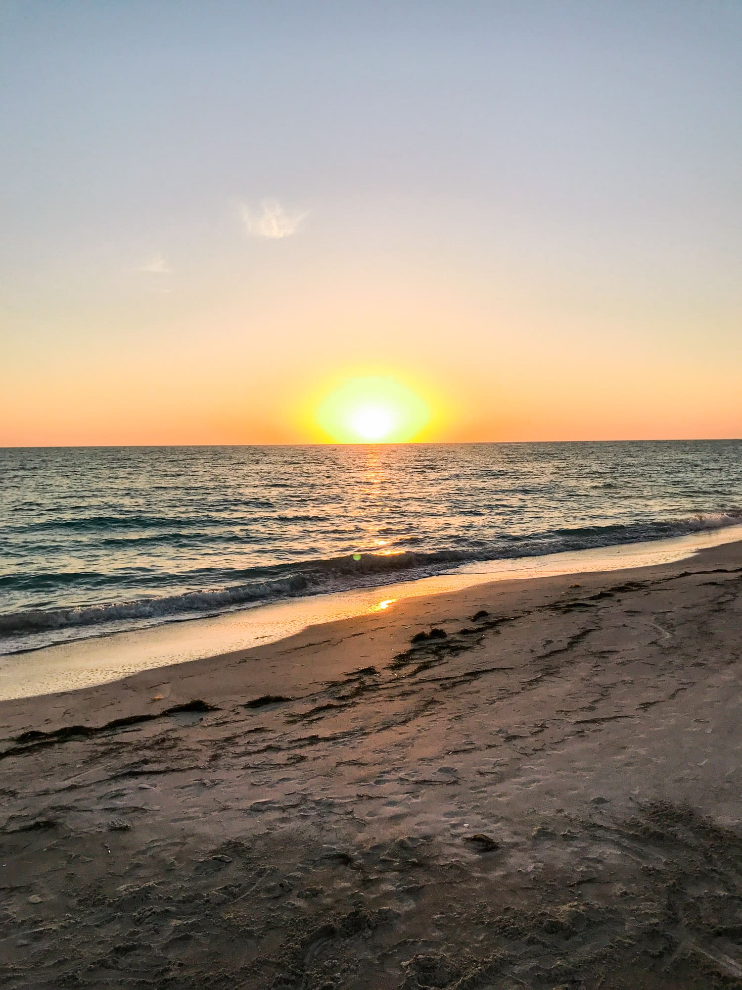 How to plan a romantic weekend getaway in Longboat Key, Florida, including a relaxing stay at The Resort at Longboat Key Club! #LoveFL sponsored by @visitflorida | sunset at Lido Beach | Florida travel tips, beach vacation, vacation ideas, vacation goals, travel blogger Ashley Brooke Nicholas, Florida travel guide, Longboat Key travel guide, Sarasota travel guide, beautiful beaches, boating, affordable travel, US travel, summer vacation, spring break ideas, romantic vacation