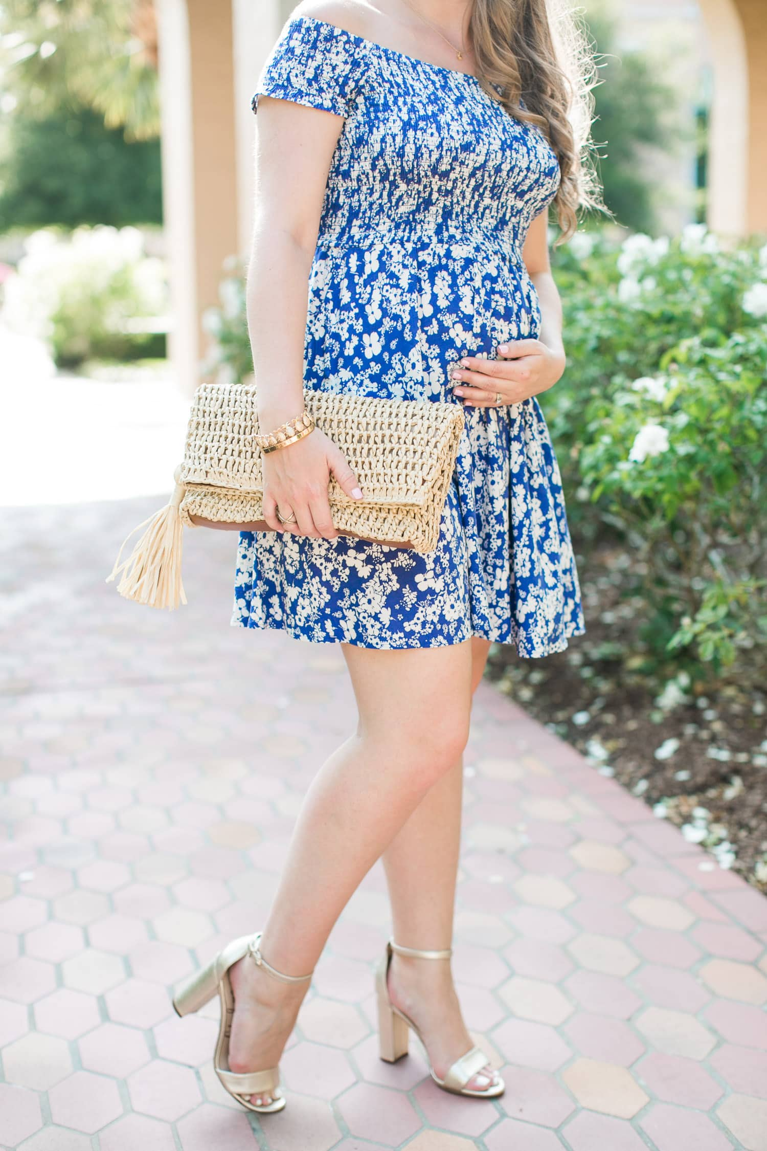 The best dress - ever. This Express off the shoulder dress is so cute, so comfortable, and perfect for a cute maternity outfit for summer! | cute summer outfit, Express blue dress, Sam Edelman metallic gold heels, Baublebar pinata tassel earrings, Ann Taylor straw tassel clutch, raffia clutch, Baublebar pineapple bracelet, best Memorial Day Weekend sales, sale finds, styled by Florida fashion blogger Ashley Brooke Nicholas, 2nd trimester pregnancy outfits, maternity fashion, maternity style