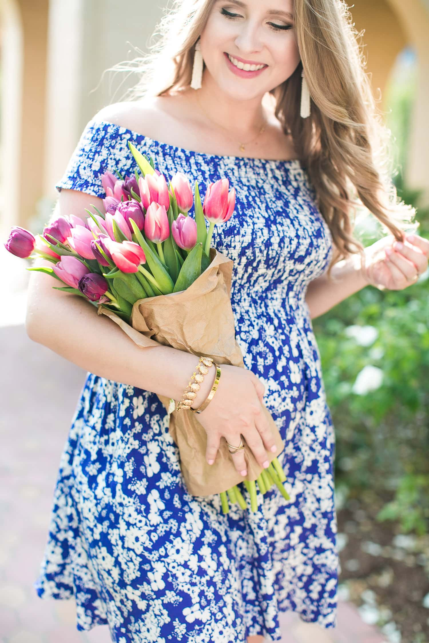 Pretty tulips + the cutest jewelry ever. | cute summer outfit, Express blue dress, Sam Edelman metallic gold heels, Baublebar pinata tassel earrings, Ann Taylor straw tassel clutch, raffia clutch, Baublebar pineapple bracelet, best Memorial Day Weekend sales, sale finds, Florida fashion blogger Ashley Brooke Nicholas, 2nd trimester pregnancy outfits, maternity fashion, maternity style