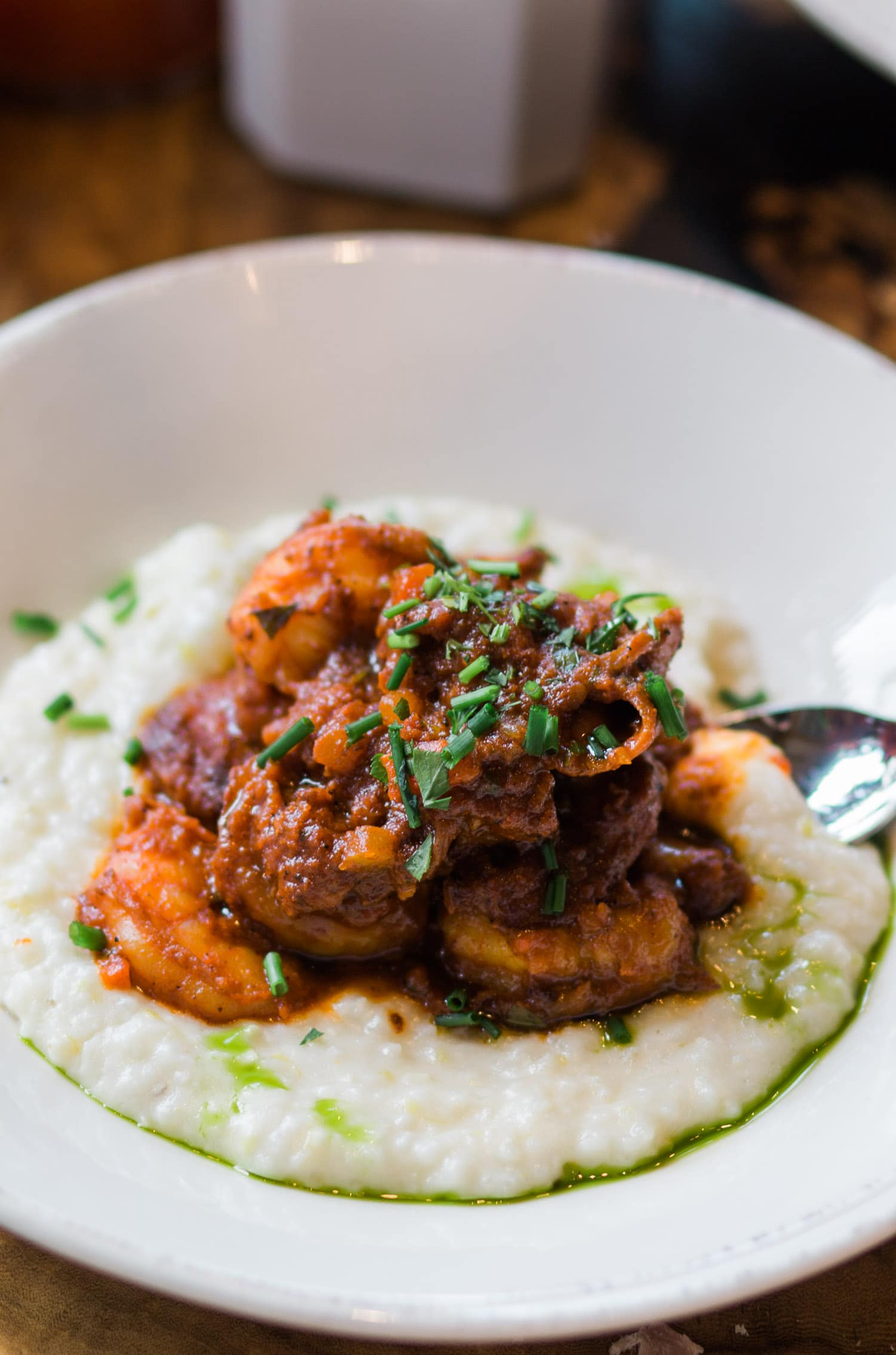 Shrimp and Grits at Homecomin' Restaurant in Disney Springs | Planning a trip to Orlando? I've rounded up the top 10 things to do in Orlando, Florida, that are guaranteed to make your trip a success. Whether you're moving to Orlando or just headed in on vacation, you will LOVE this list of fun activities in Orlando by Florida travel blogger Ashley Brooke Nicholas #CORTatHome sponsored by   @cortfurniture    affordable travel tips, orlando vacation tips, vacation tips, orlando eye, leu gardens, universal studios, islands of adventure, disney, disney springs