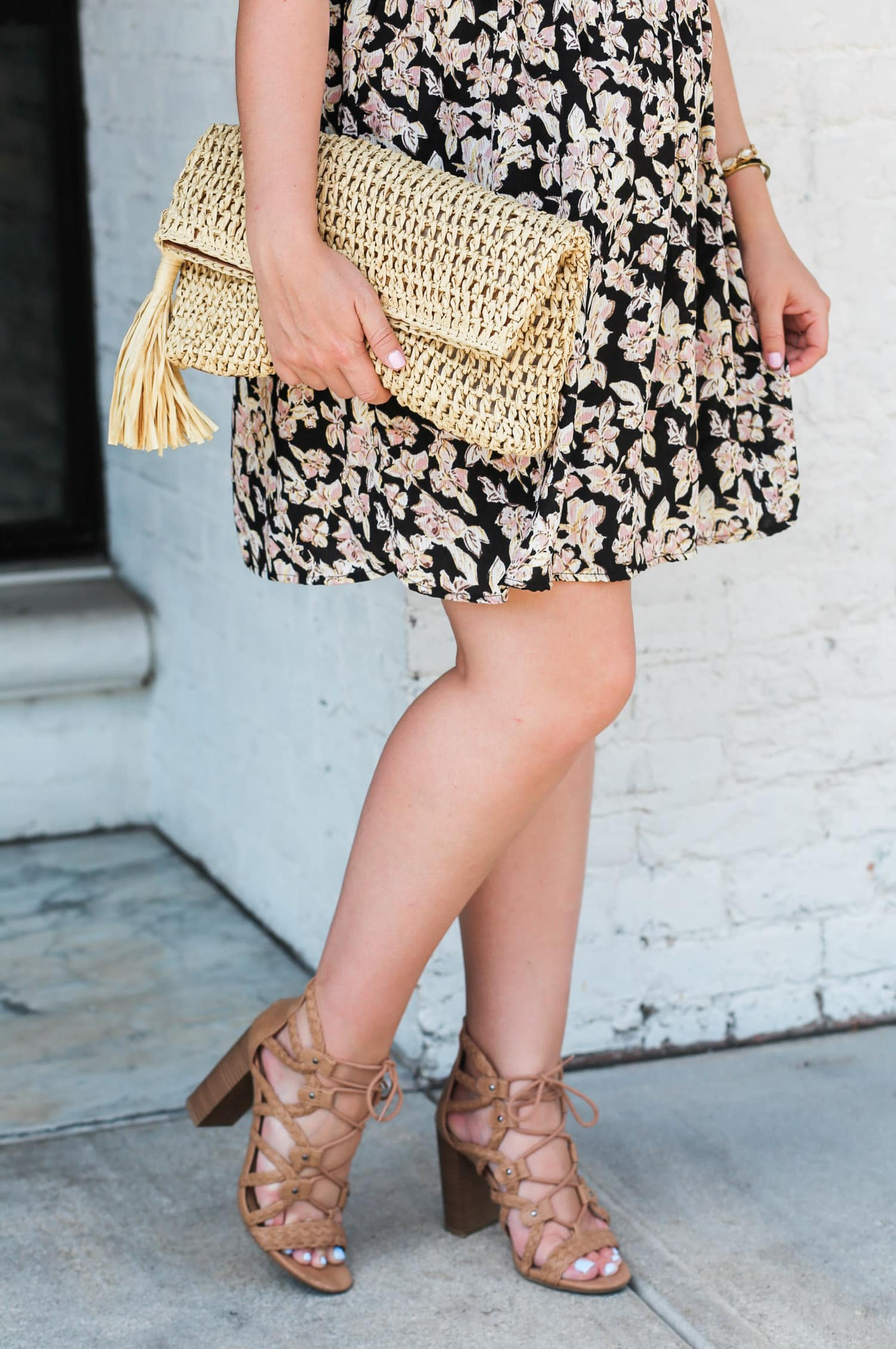 Loving these nude lace up sandals for summer! Can you believe these gorgeous nude gladiator heeled sandals are also under $25? Click through this pin to see this cute summer outfit idea styled by Orlando, Florida fashion blogger Ashley Brooke Nicholas! | Floral off the shoulder dress, straw clutch with tassel, raffia clutch, lace up sandals, lace up heels, cute summer heels, affordable outfit ideas, fashion blogger outfits, feminine style