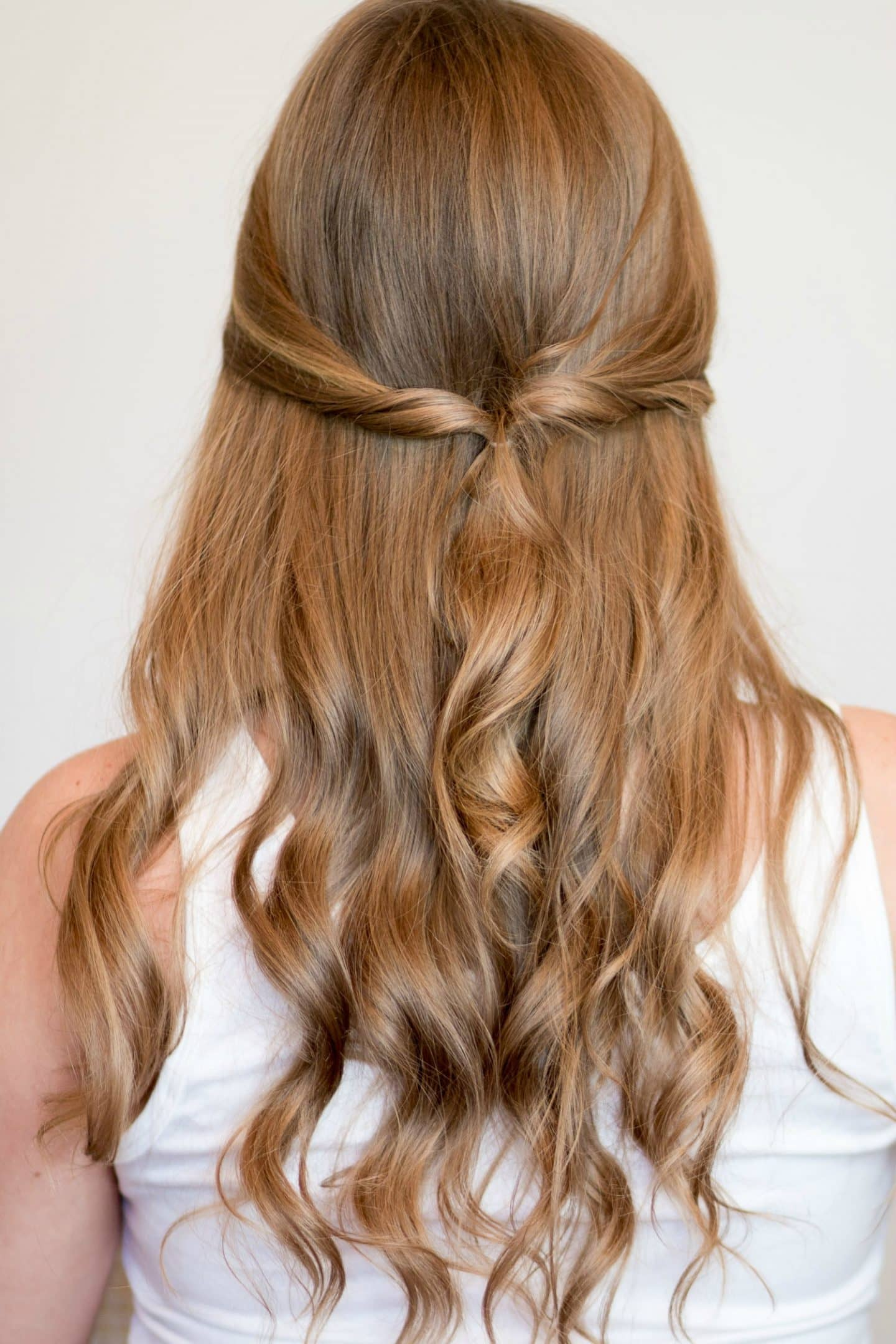 Twisted half-up half-down heatless hairstyle tutorial | 4 Easy heatless hairstyles for long hair that don't require hair styling skills or braiding! Learn how to create a faux braided ponytail, messy faux fishtail braid, twisted half-up, and messy braided bun in these easy hair tutorial by Orlando, Florida beauty blogger Ashley Brooke Nicholas! #MyHCLook sponsored by Hair Cuttery! | easy hairstyles, no-heat hairstyle