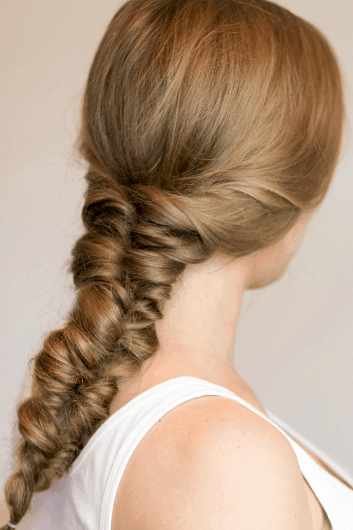 Messy faux fishtail braid that doesn't require any braiding | 4 Easy heatless hairstyles for long hair that don't require braiding! Learn how to create a faux braided ponytail, messy faux fishtail braid, twisted half-up, and messy braided bun in these easy hair tutorial by Orlando, Florida beauty blogger Ashley Brooke Nicholas! #MyHCLook sponsored by Hair Cuttery! | easy hairstyles, no-heat hairstyle, faux braids, faux braid tutorial, how to braid your hair