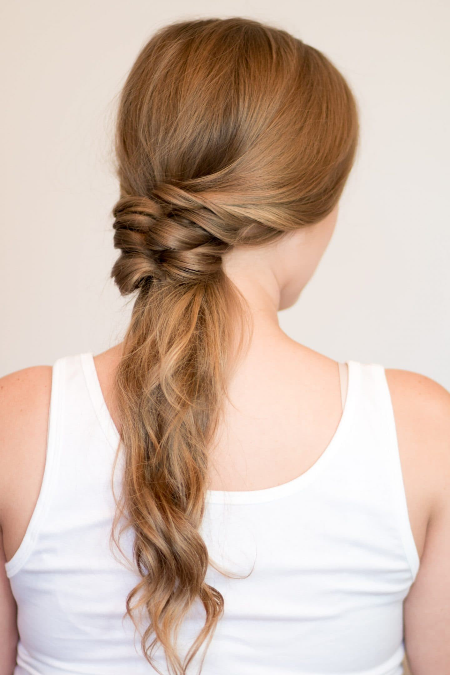 Faux Braided Ponytail hair tutorial | 4 Easy heatless hairstyles for long hair that don't require hair styling skills or braiding! Learn how to create a faux braided ponytail, messy faux fishtail braid, twisted half-up, and messy braided bun in these easy hair tutorial by Orlando, Florida beauty blogger Ashley Brooke Nicholas! #MyHCLook sponsored by Hair Cuttery! | easy hairstyles, no-heat hairstyle, faux braids, faux braid tutorial, how to braid your hair, fishtail braid, long dirty blonde hair