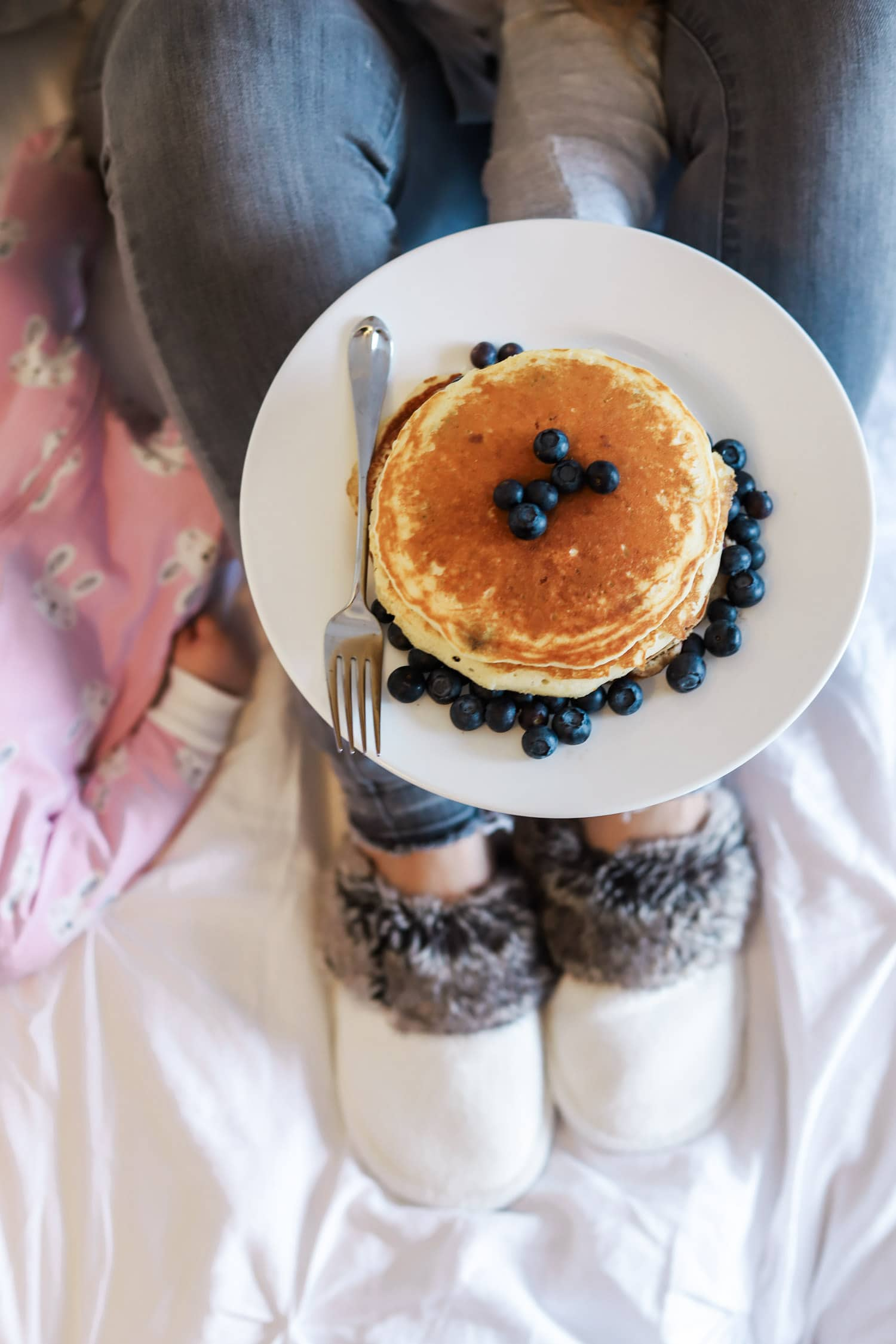 Manage stress around holidays pancake breakfast blueberries   Ashley Brooke Nicholas blogger   fuzzy slippers   cute baby