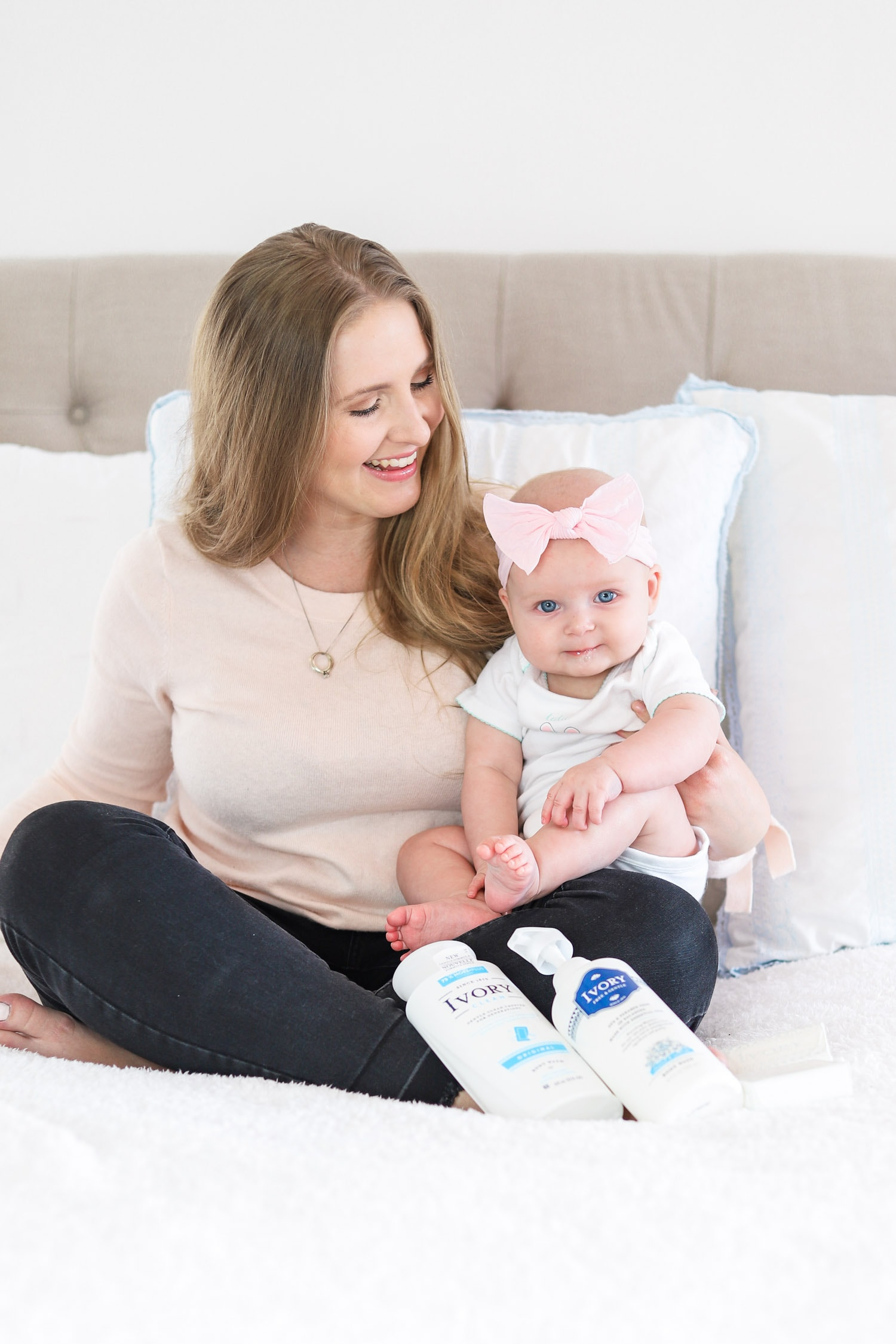 Happy mom and baby sitting on bed | Ivory lotion | grandmother's beauty secrets | Ashley Brooke Nicholas