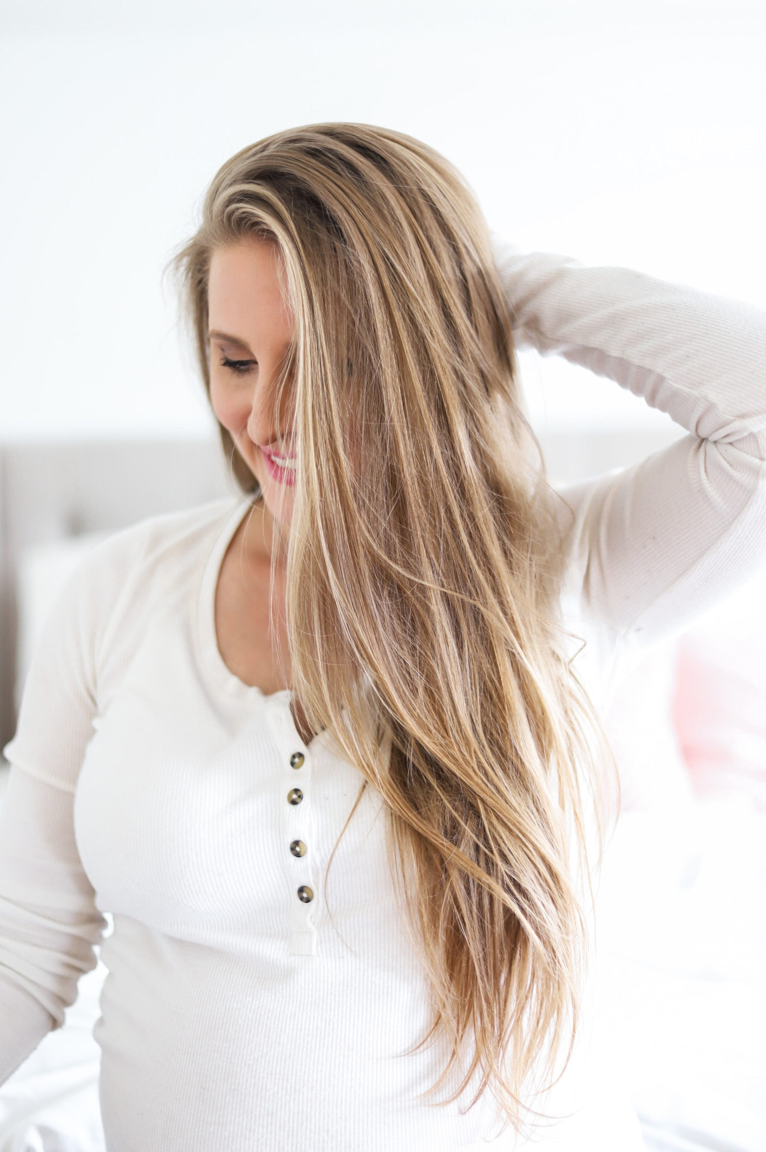 Learn how to get a salon-quality blowout at home in less time with Orlando, Florida beauty blogger Ashley Brooke Nicholas in this easy blog and video tutorial.