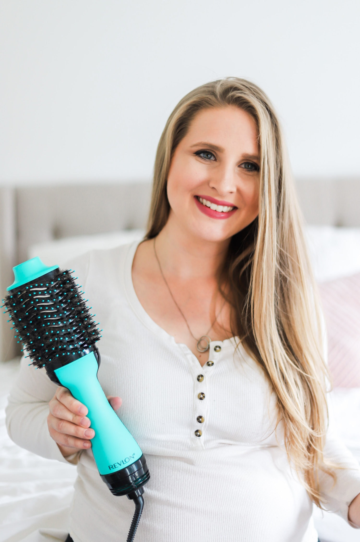 How to get a salon-quality blowout at home with the Revlon One-Step Volumizer and Hair Dryer in Orlando, Florida beauty blogger's easy step-by-step video tutorial.