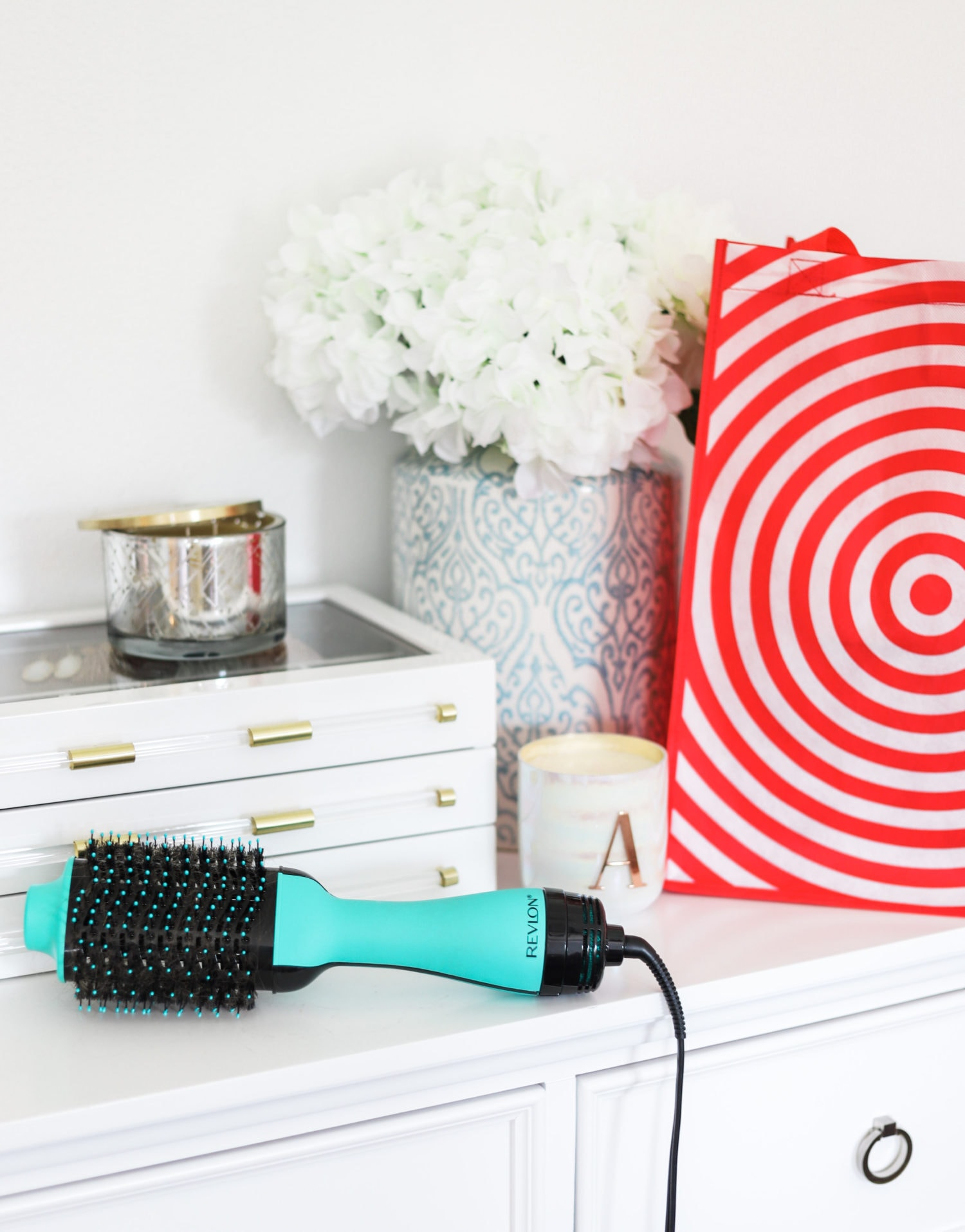 How to get a salon-quality blowout at home with the Revlon One-Step Volumizer and Hair Dryer in Orlando, Florida beauty blogger's easy step-by-step video tutorial. Teal color is exclusive to Target