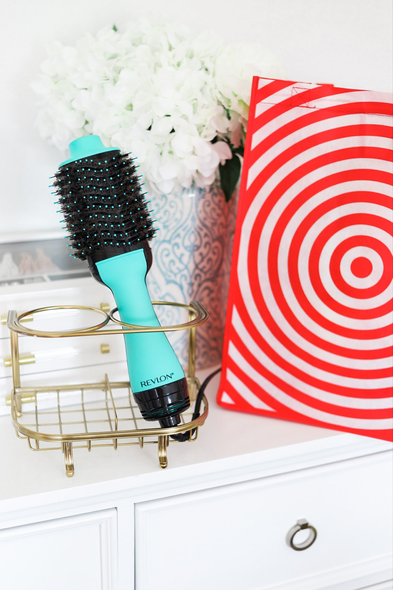 How to get a salon-quality blowout at home with the Revlon One-Step Volumizer and Hair Dryer in Orlando, Florida beauty blogger's easy step-by-step video tutorial. Get the new teal color at Target