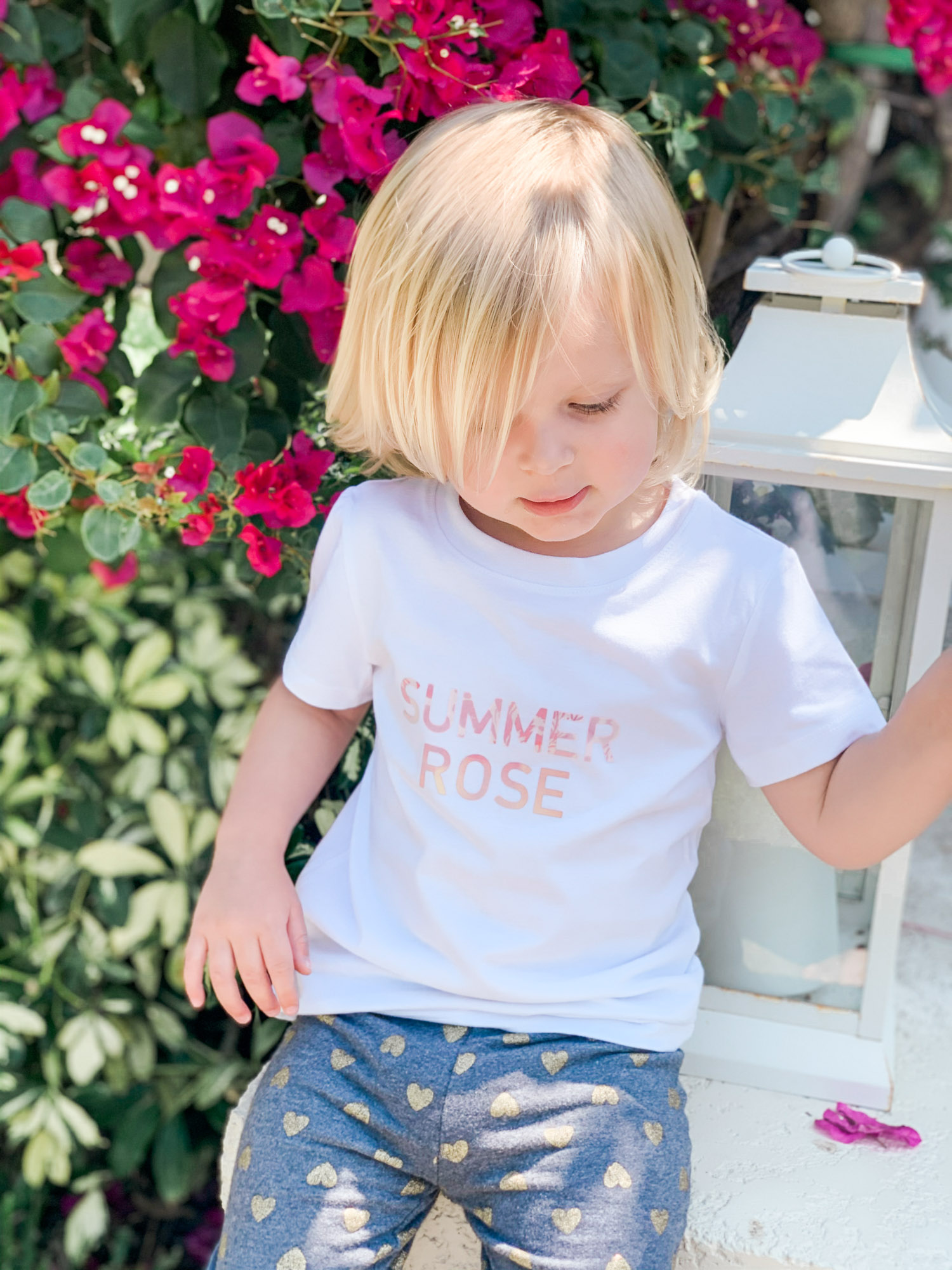 How to make DIY watercolor custom shirts with kids names with this easy Cricut Joy tutorial from Orlando lifestyle blogger Ashley Brooke Nicholas.